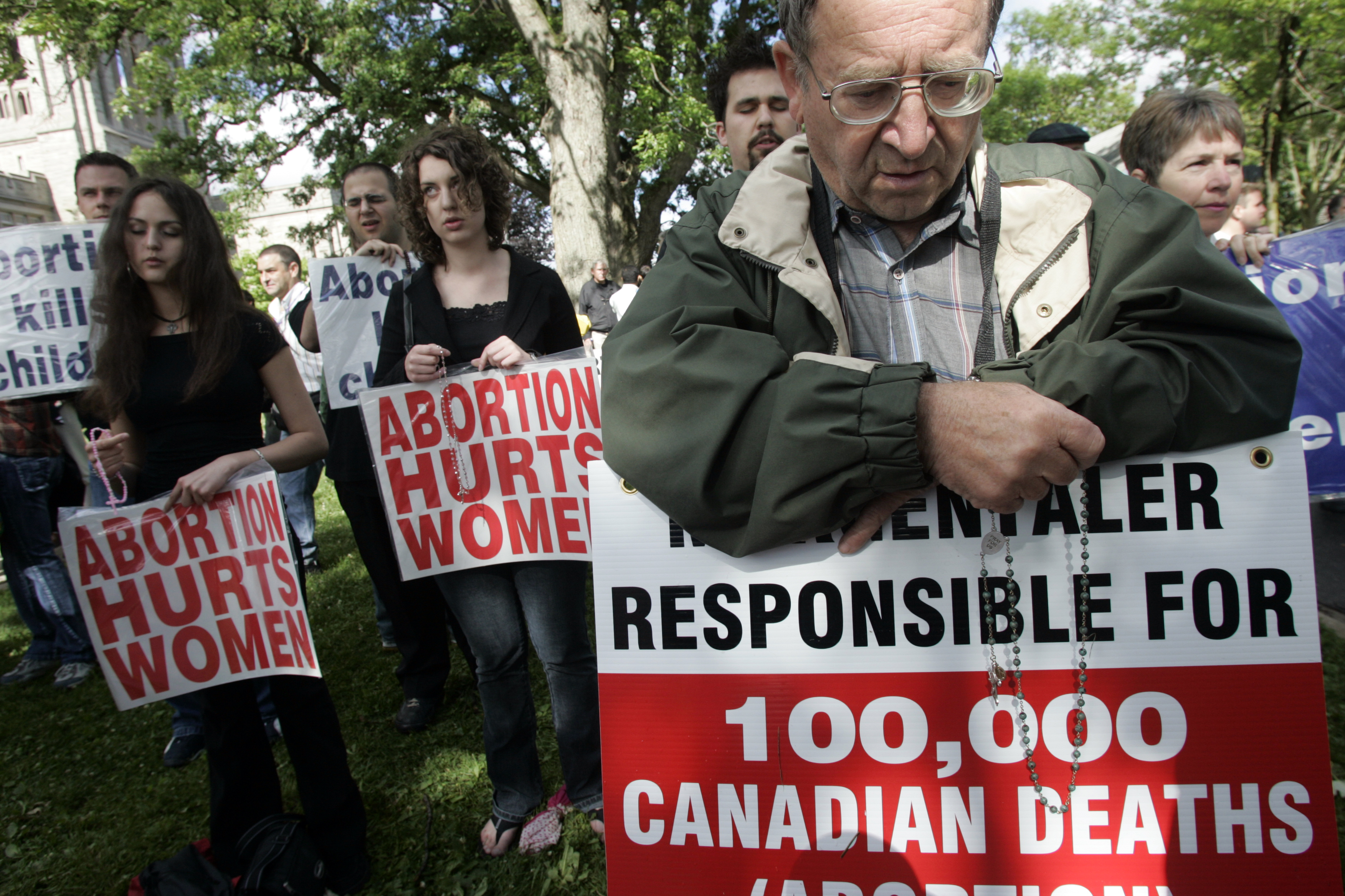 Hundreds of anti-abortion activists marched through                   the streets of London, Ontario and demonstrated outside a University of Western Ontario event on June 16, 2005.