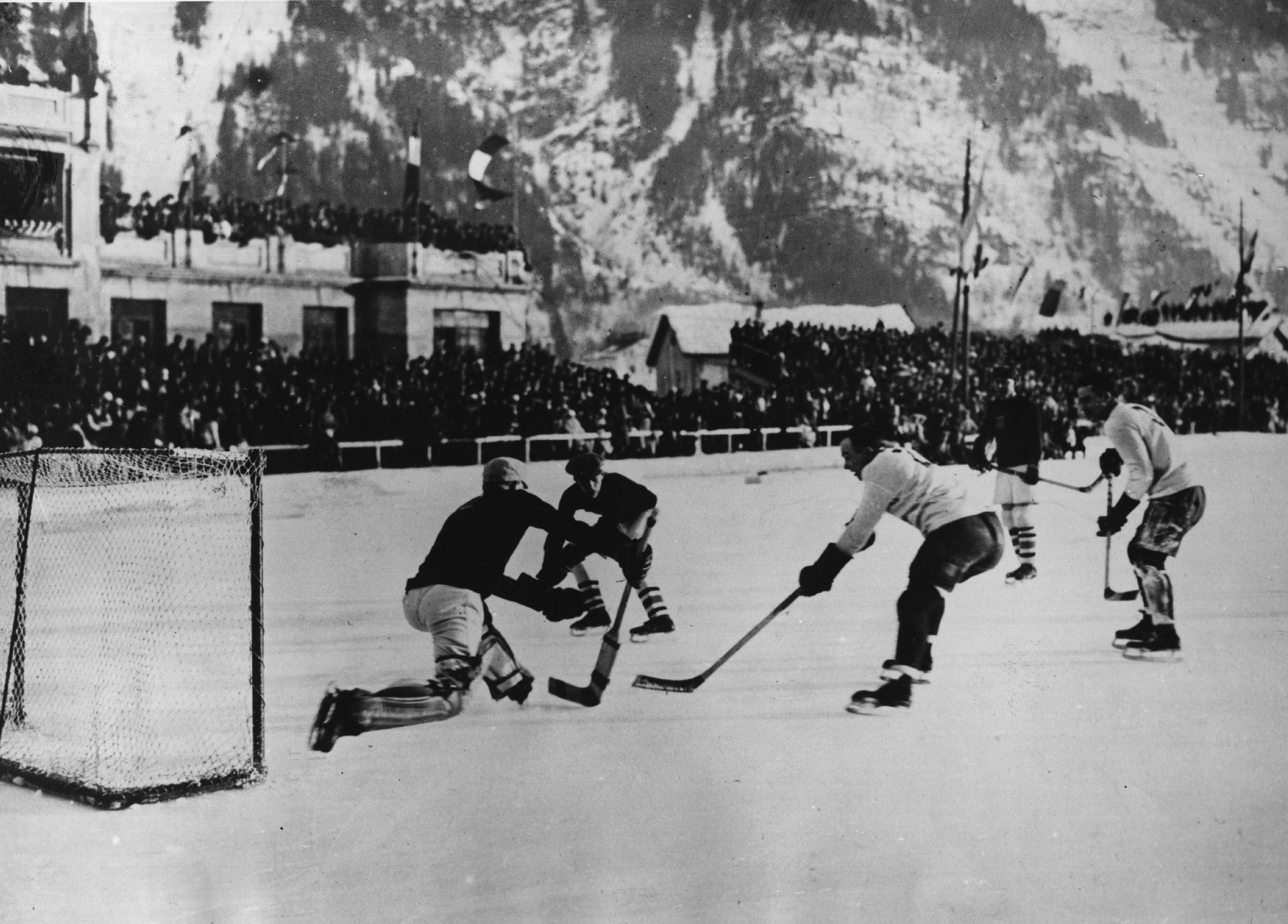 National teams from Canada and the USA in action during an ice hockey match at the first Winter Olympics at Chamonix in 1924.