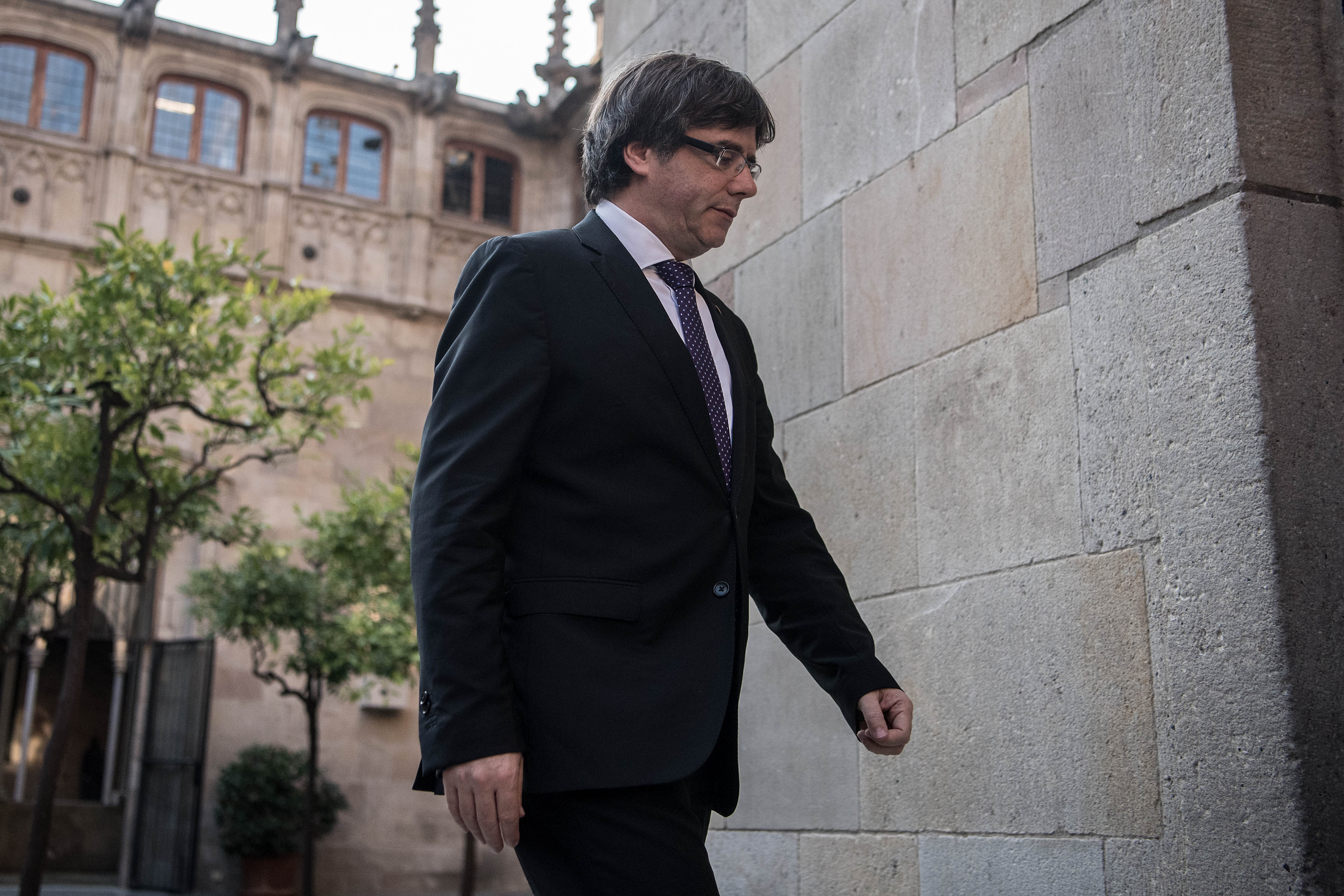 Carles Puigdemont arrives at a government meeting at the Palau de la Generalitat building on October 17, 2017 in Barcelona, Spain.