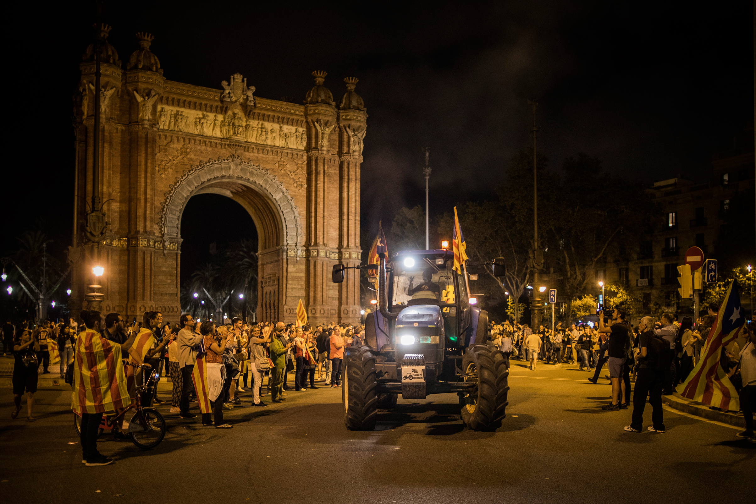 A supporter of independence drives a tractor near Barcelona's Arc de Triomf after Puigdemont's remarks on Oct. 10