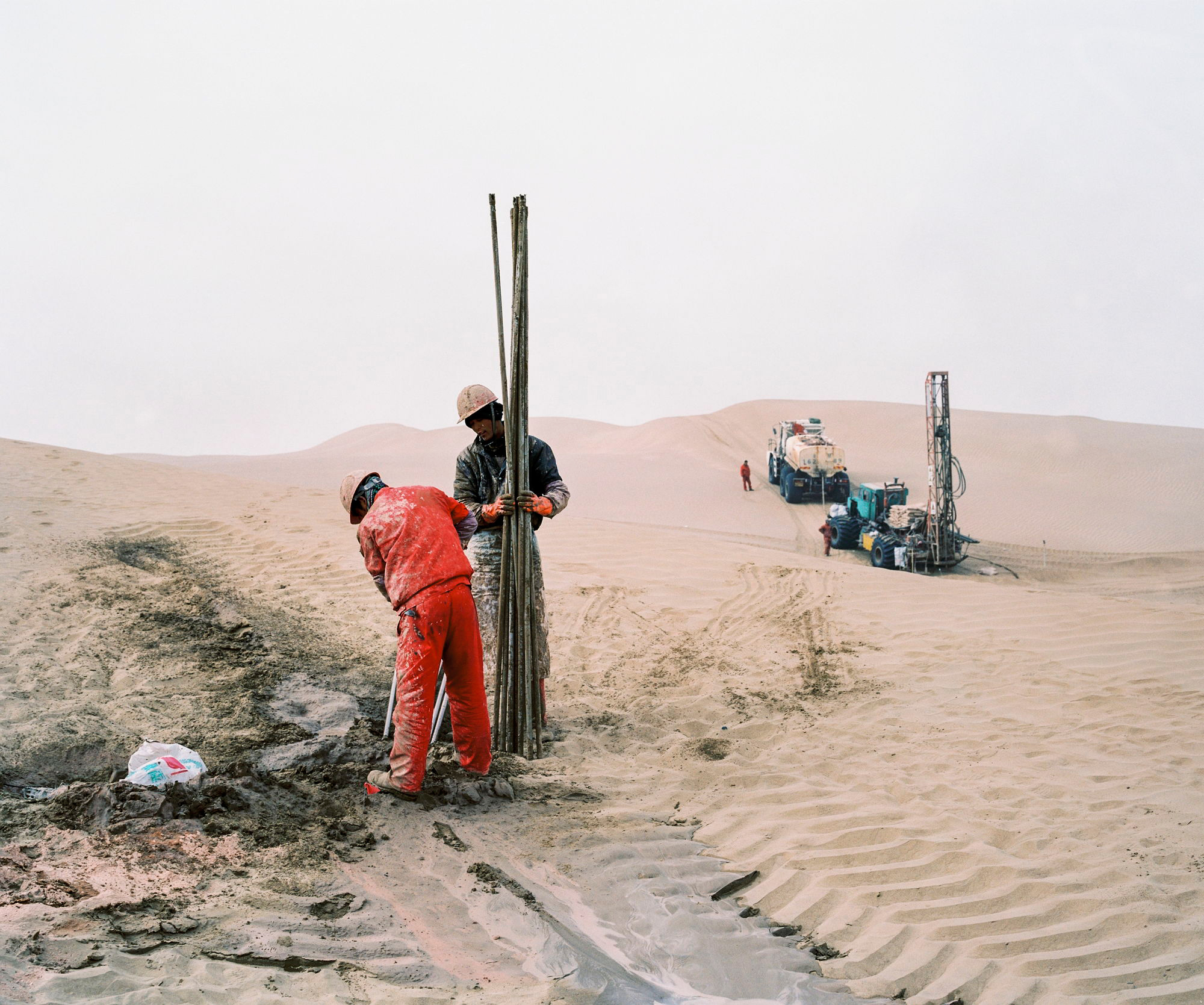 An oil exploration team from a Chinese state-owned company operates in the Taklamakan Desert, in China's westermost province of Xinjiang, in December 2016.