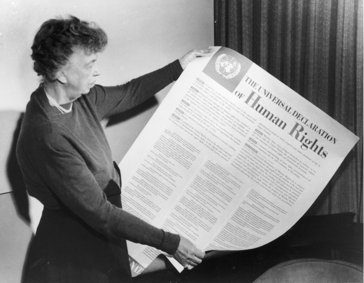 Eleanor Roosevelt holds up a copy of 'THE UNIVERSAL DECLARATION OF HUMAN RIGHTS', circa 1947.