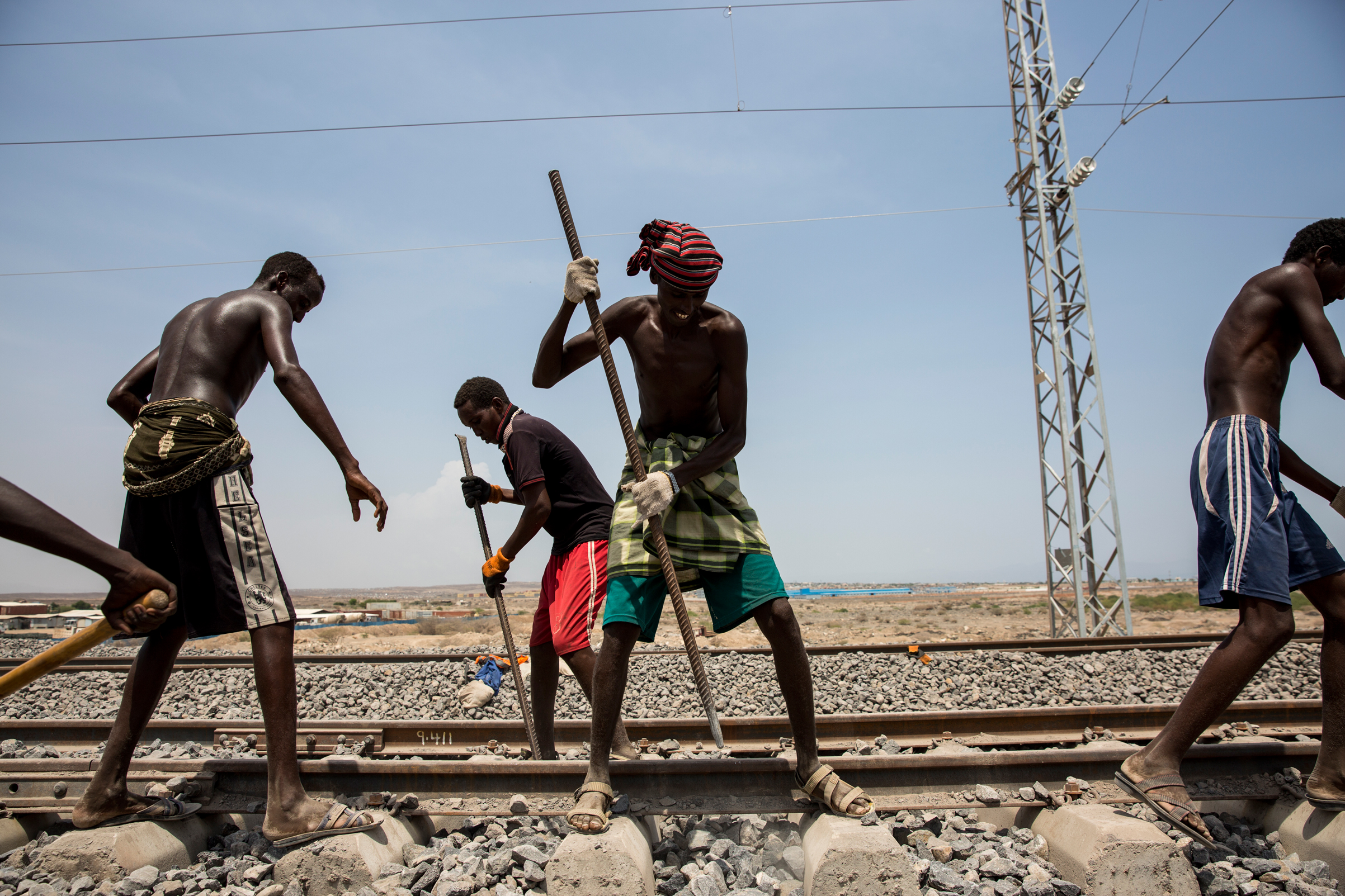 Workers maintain and check the Addis Ababa-Djibouti railway during a trial run in Addis Ababa, Ethiopia, on Sept. 28, 2016. Days later, after four years of construction and funding by the Chinese, it opened to become Africa's first cross-border electric railway.