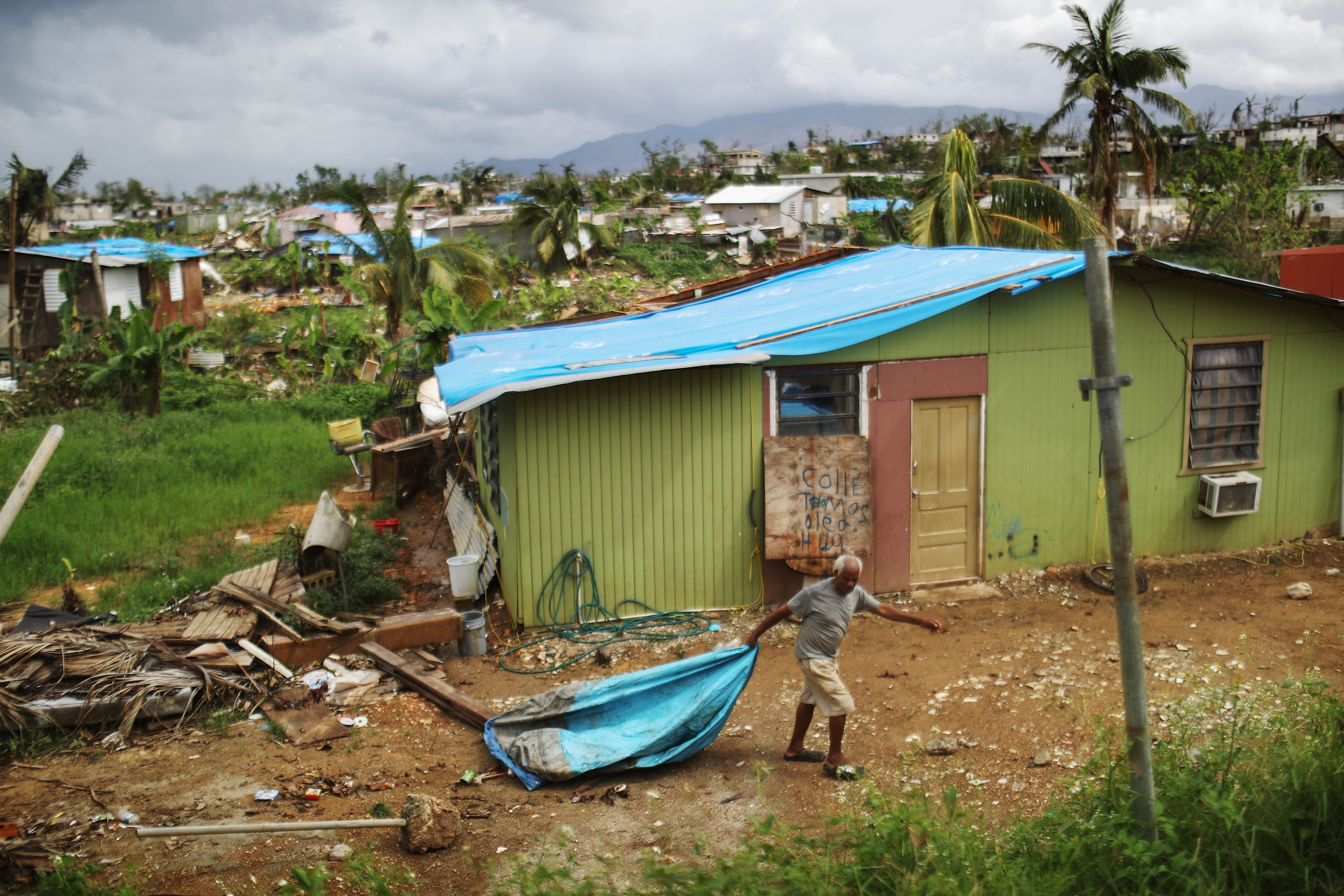 A local resident cleans debris near his damaged home in an area without electricity on Oct. 15, 2017 in San Isidro, Puerto Rico. Puerto Rico is suffering shortages of food and water in many areas and only 15 percent of grid electricity has been restored. Puerto Rico experienced widespread damage including most of the electrical, gas and water grid as well as agriculture after Hurricane Maria, a category 4 hurricane, swept through.