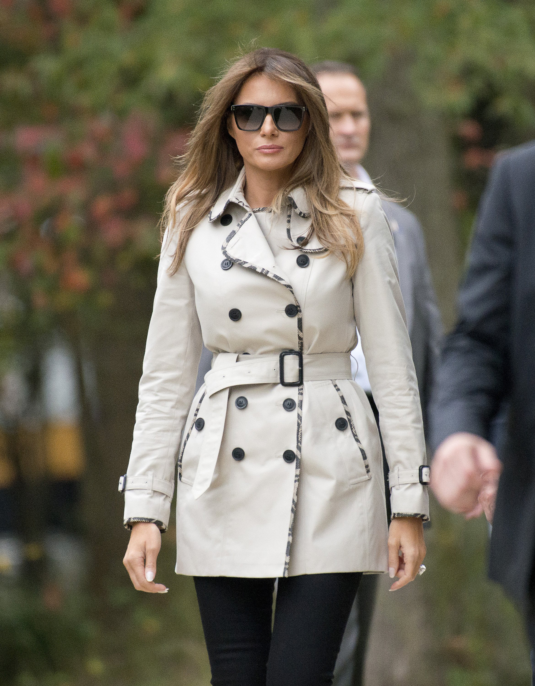 First lady Melania Trump wears a trench coat with trim, as she accompanies her husband on a tour of the U.S. Secret Service James J. Rowley Training Center Oct.13, 2017 in Beltsville, Md.