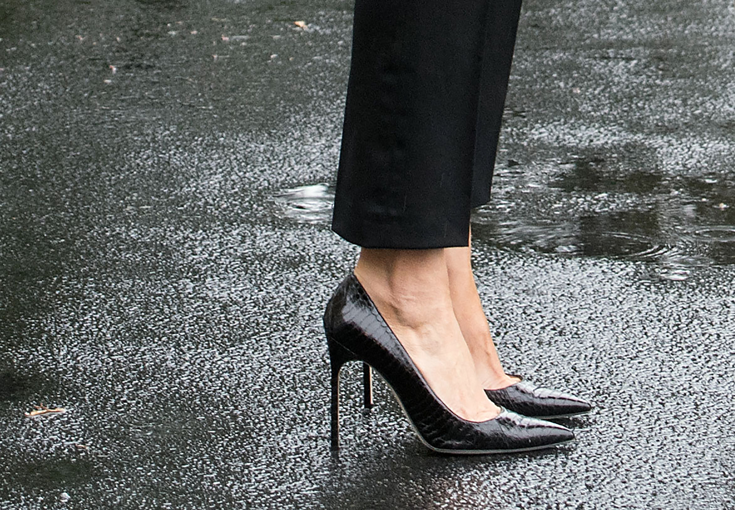 First lady Melania Trump wearing black Manolo Blahnik stilettos before leaving for Texas to observe the Hurricane Harvey relief efforts, Aug. 29, 2017.
