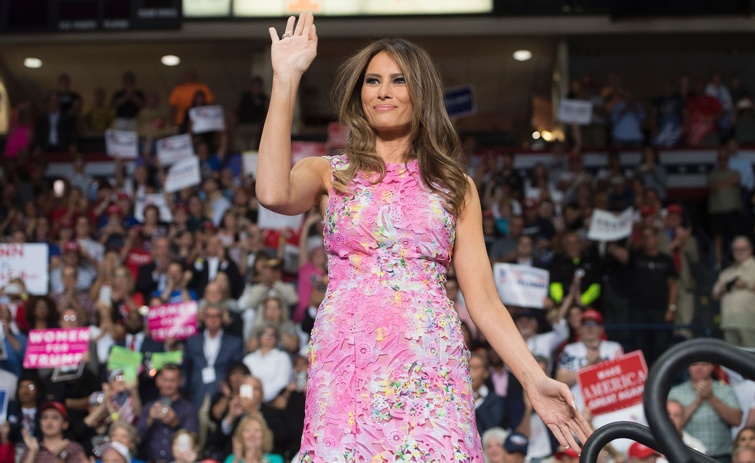 First lady Melania Trump wearing  a floral, pink Monique Lhuillier dress with waves during a Make America Great Again rally at the Covelli Centre in Youngstown, Ohio, July 25, 2017.