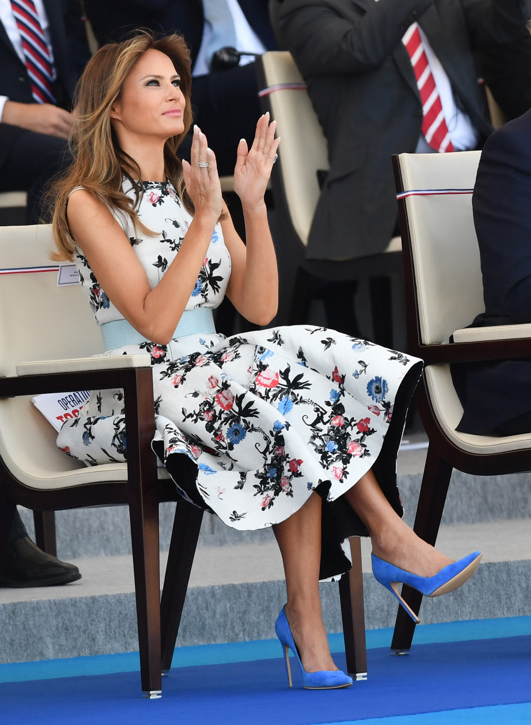 First lady Melania Trump wears a Valentino dress and Manolo Blahnik shoes, while attending the annual Bastille Day military parade along Avenue des Champs-Elysees in Paris, France on July 14, 2017.