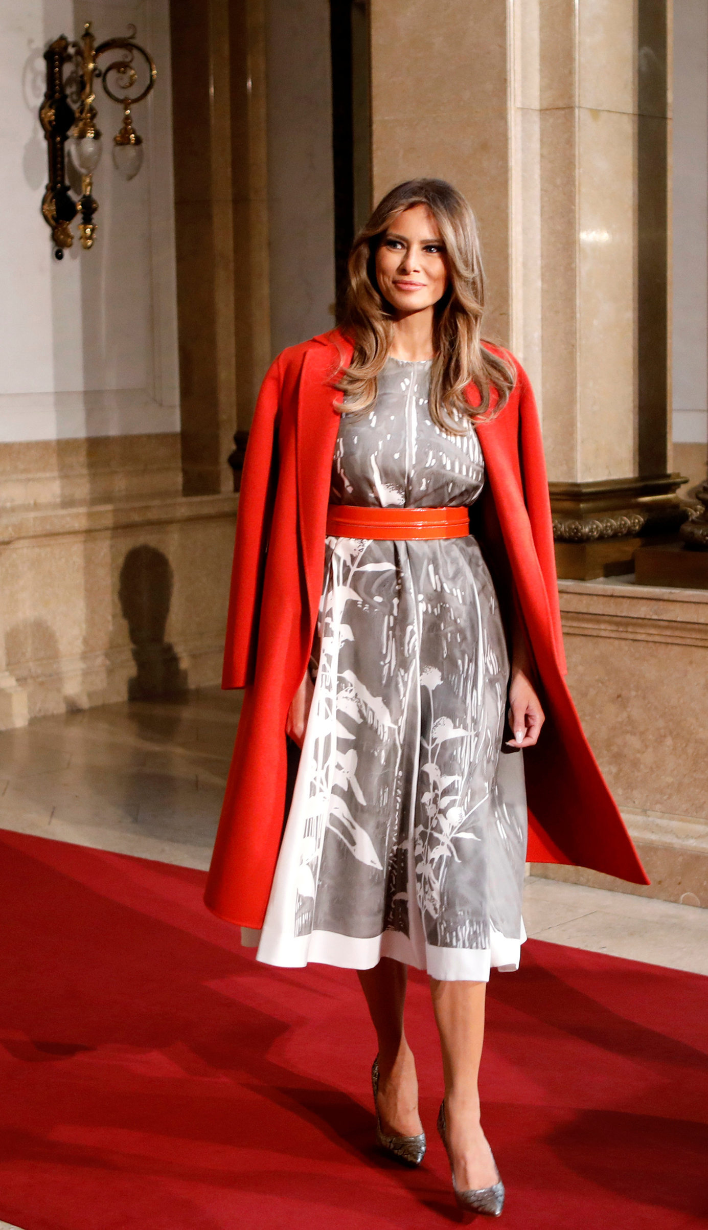 First lady Melania Trump wearing a Bottega Veneta red coat and a Jil Sander silk dress, arrives to attend the partners' programme at the city hall during the G20 summit in Hamburg, northern Germany, on July 8, 2017.
