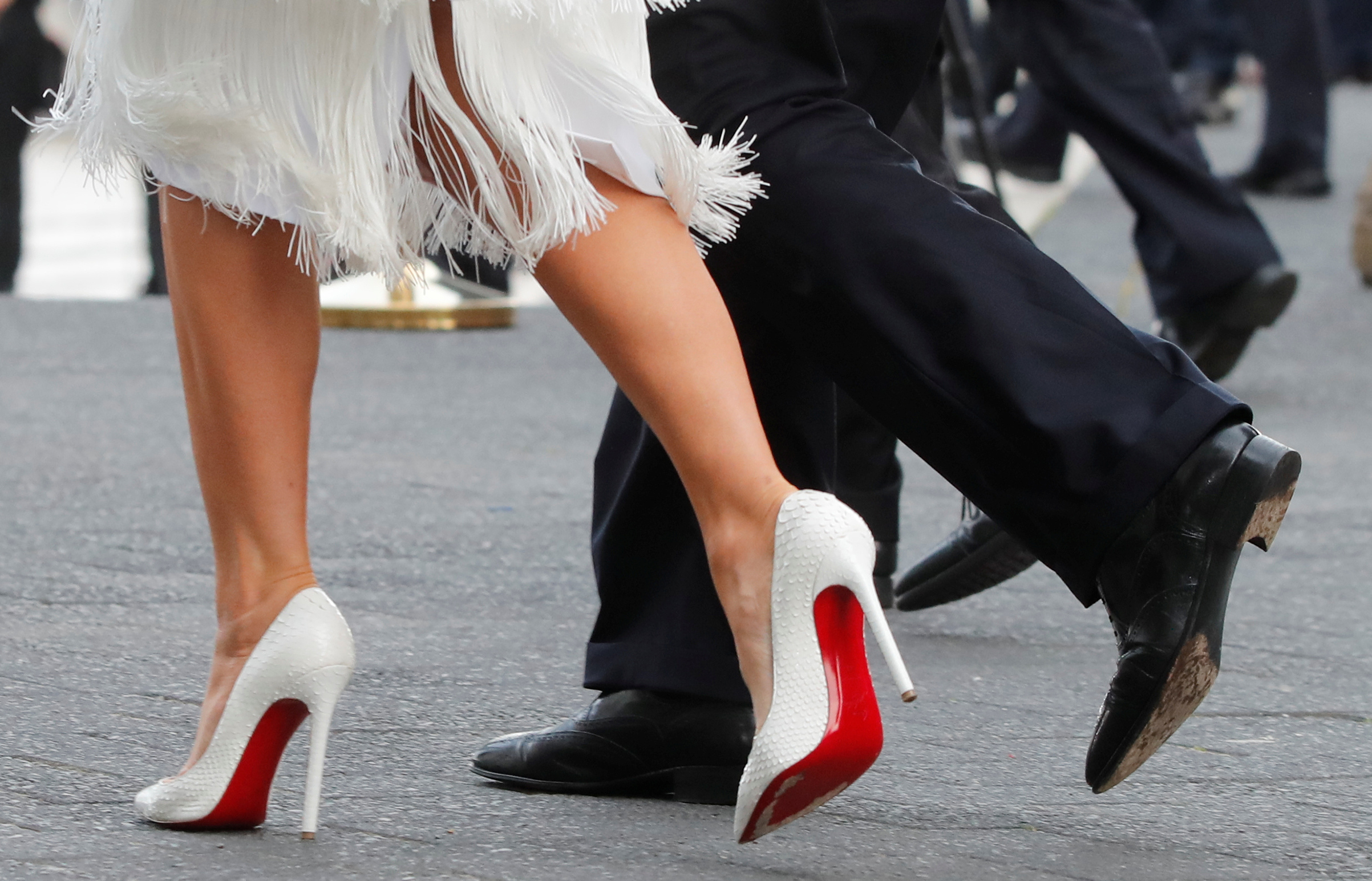 President Donald Trump and his wife Melania Trump wearing Christian Louboutin white stilettos , are seen at the G20 summit in Hamburg, Germany July 7, 2017.