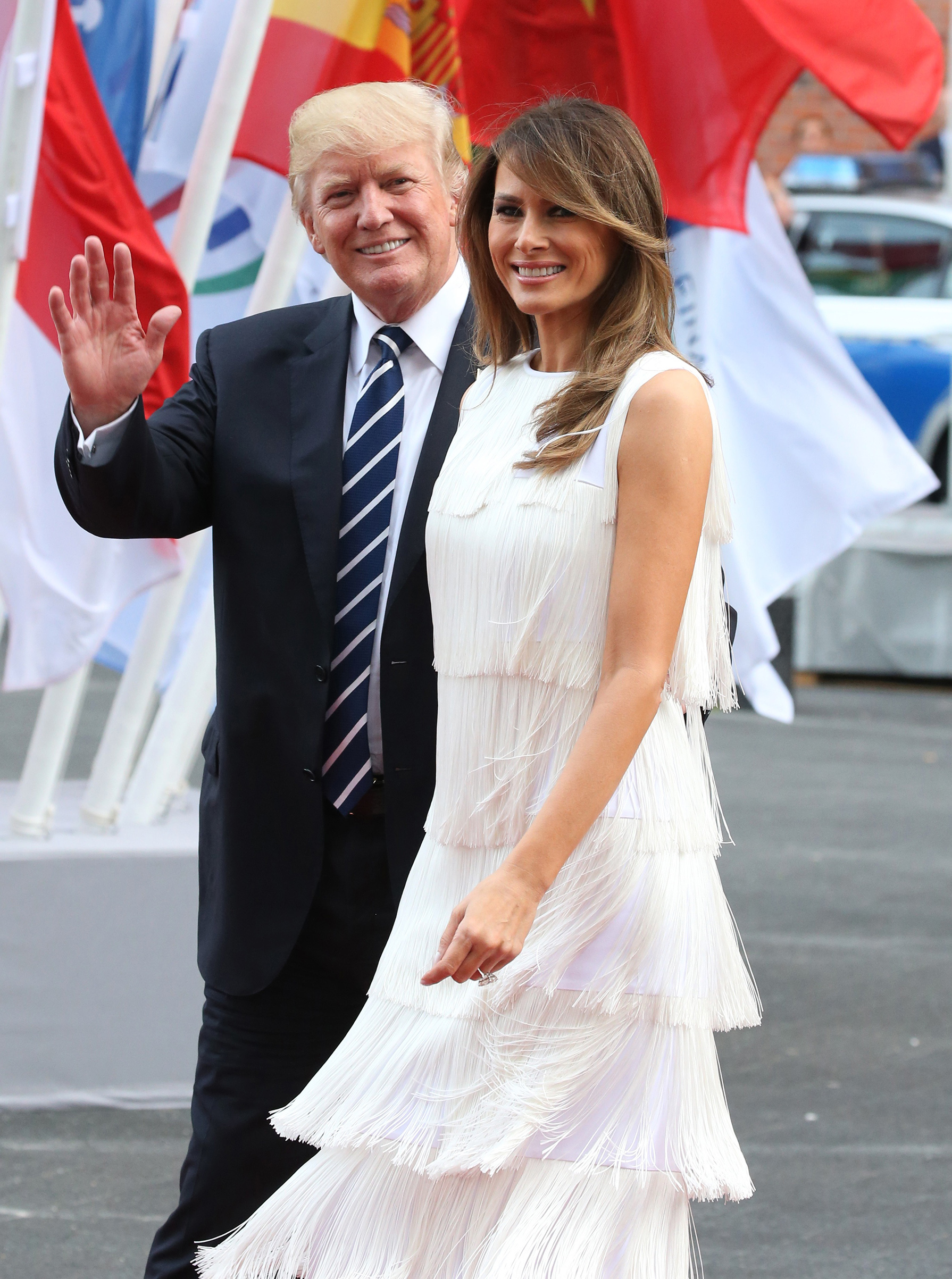 President Donald Trump (L) and first lady Melania Trump (R) wearing a Michael Kors Collection flapper style dress, arrive to the Elbphilharmonie for the dinner during the G20 Summit on July,7, 2017 in Hamburg, Germany.