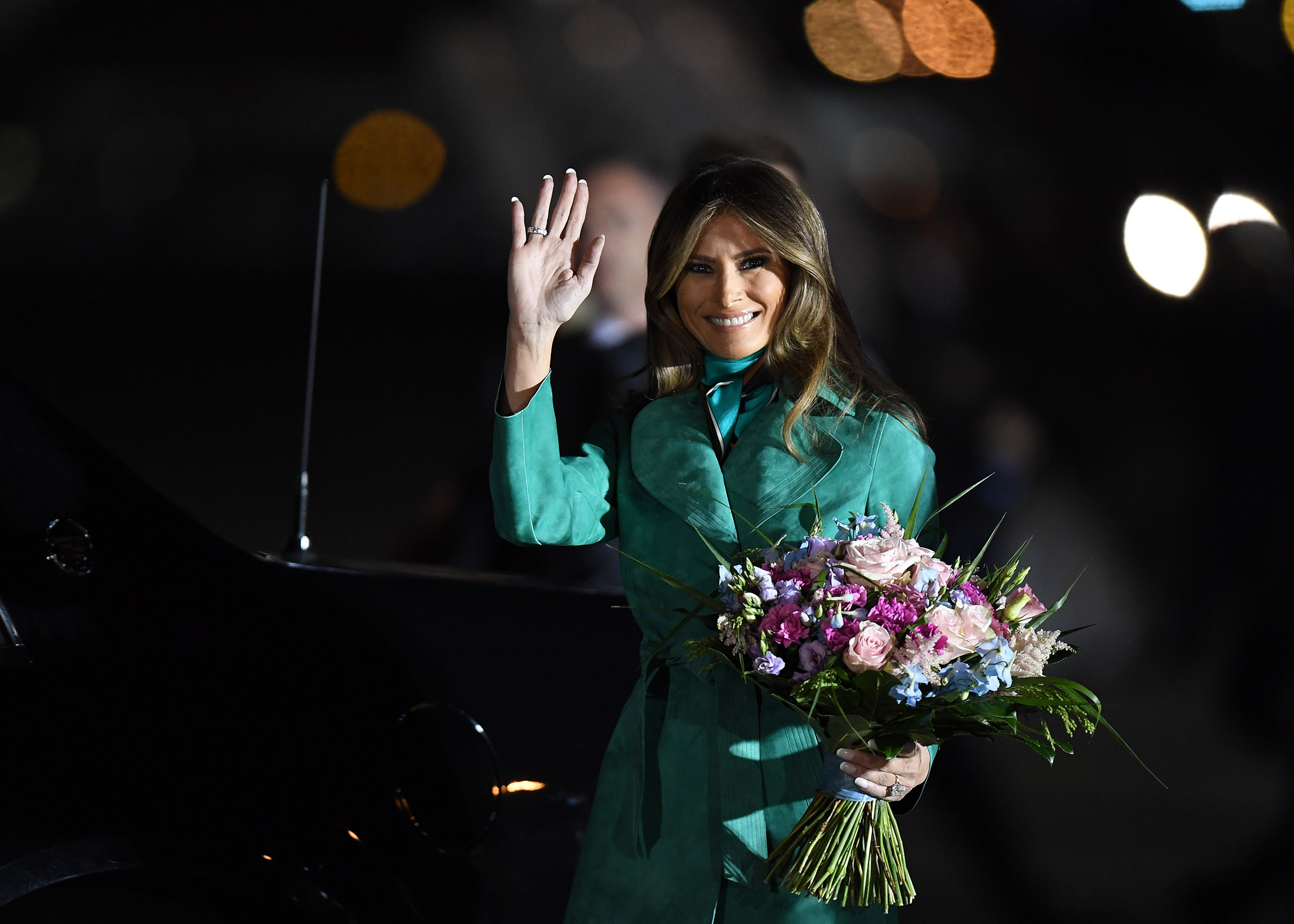 Arrival of President Trump and first lady Melania Trump, wearing green suede Diane von Furstenberg coat on July 05, 2017 in Warsaw, Poland.