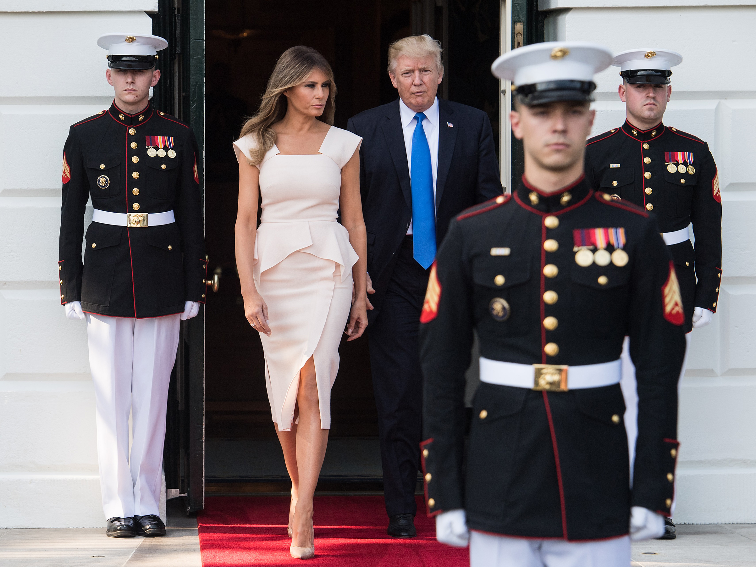 President Donald Trump and first lady Melania Trump wearing a Roland Mouret dress and Christian Louboutin shoes, walk out to receive South Korean President Moon Jae-in and his wife Kim Jeong-suk at the White House in Washington, D.C., on June 29, 2017.