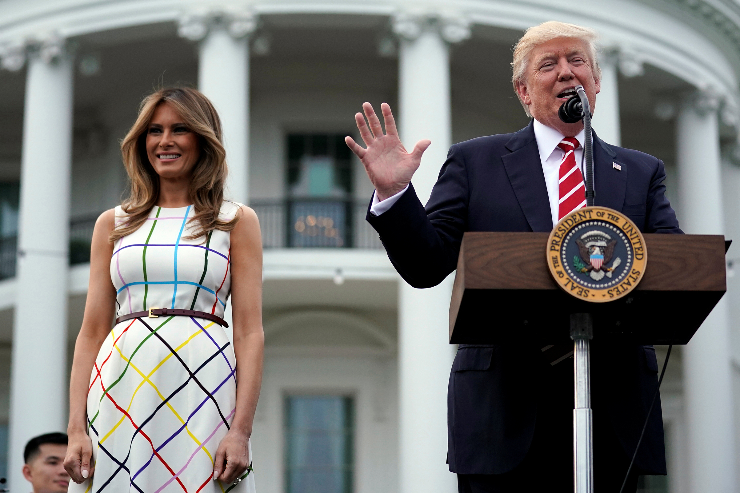 President Donald Trump delivers remarks as he hosts a Congressional picnic event, accompanied by First Lady Melania Trump wearing  a dress made in Italy by Greek designer Mary Katrantzou,  at the White House in Washington, U.S., June 22, 2017.