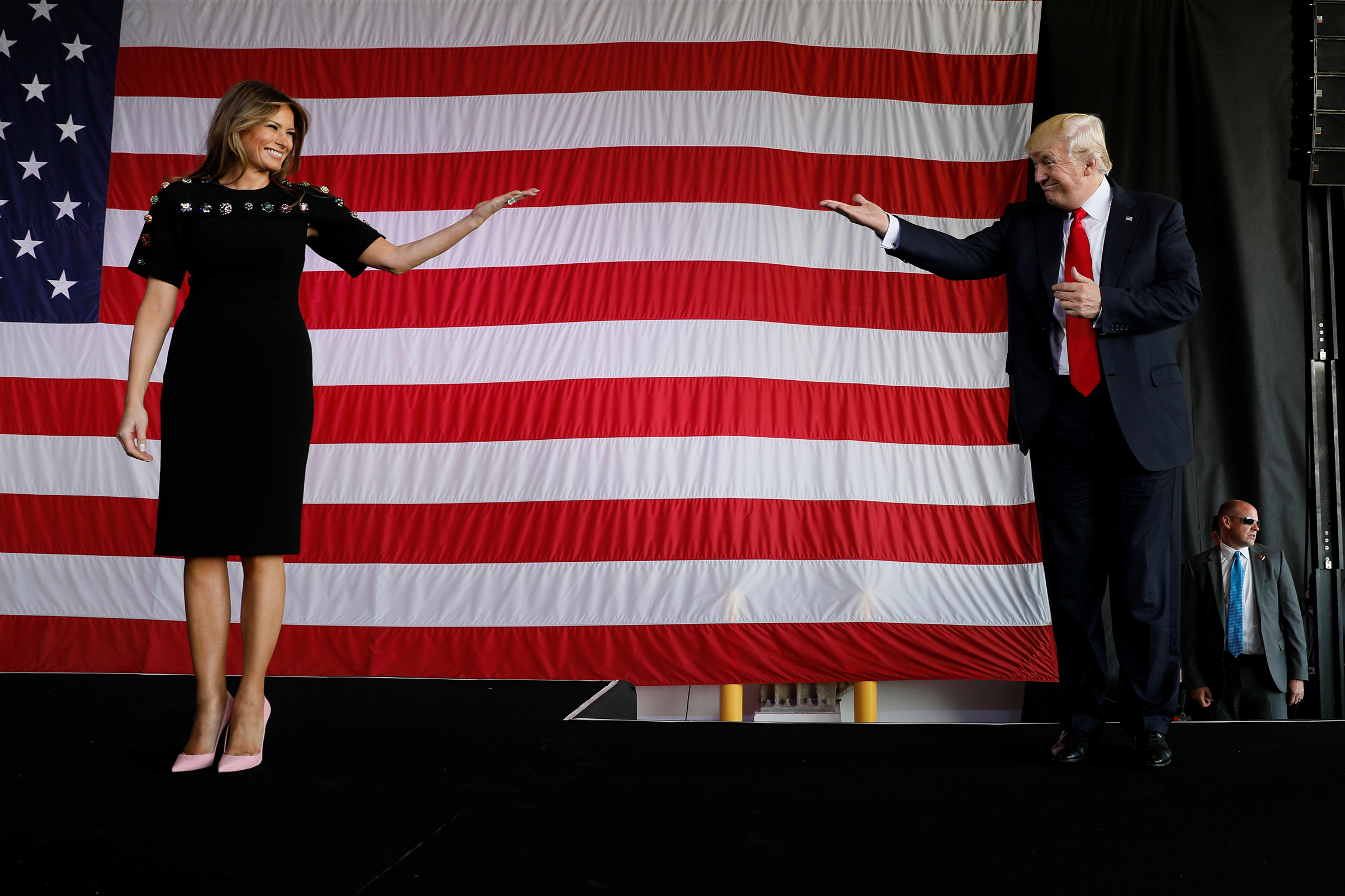 President Donald Trump and first lady Melania Trump wearing Dolce & Gabbana's dress and Christian Louboutin pink pumps, take the stage to rally with service members at Sigonella Air Force Base at Naval Air Station Sigonella at the end of Trump's participation in the G7 summit in Sicily, Italy May 27, 2017.