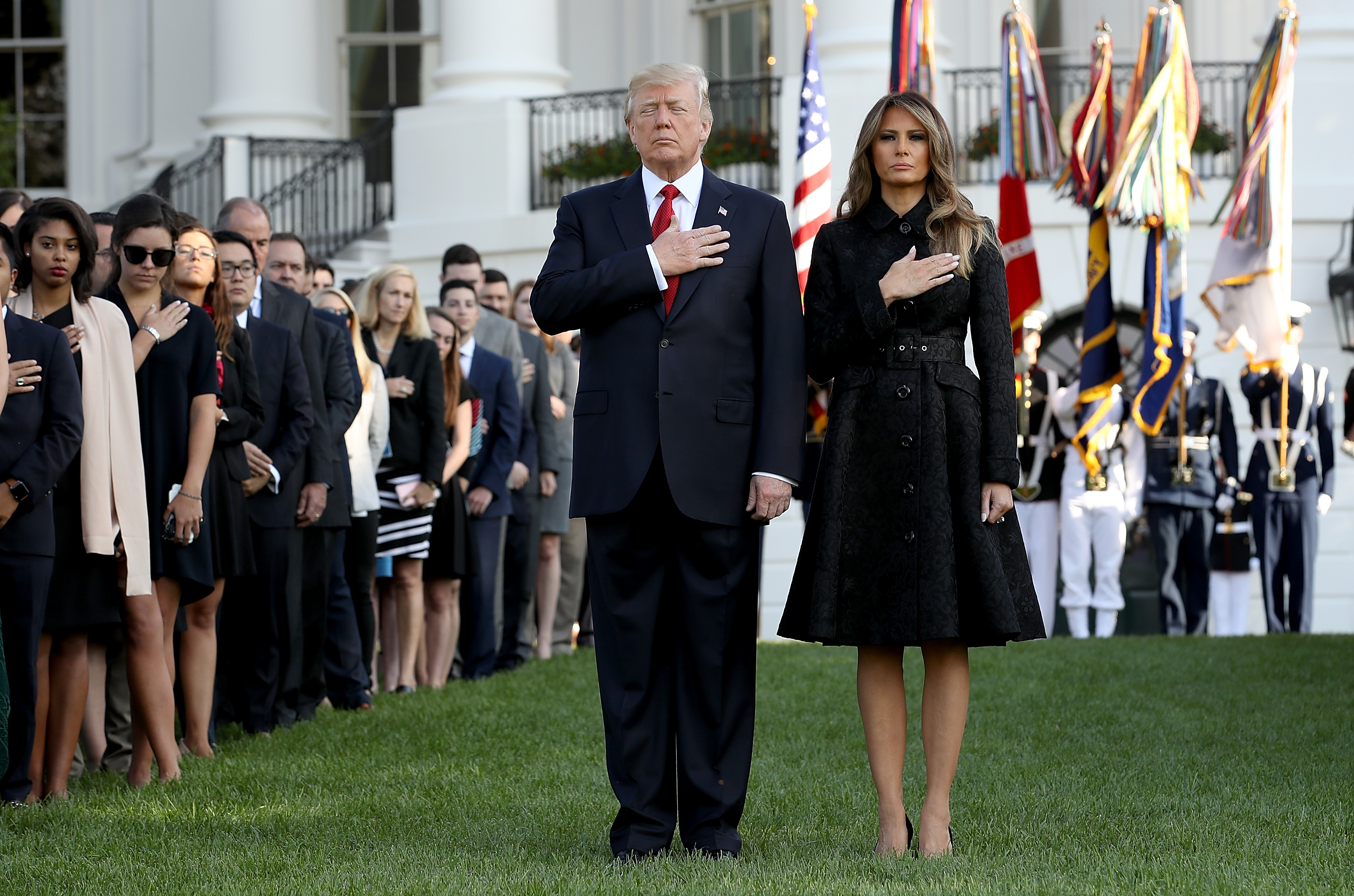 First lady Melania Trump, wear a black, long-sleeved coatdress by Michael Kors during a ceremony marking the September 11 attacks Sept.11, 2017 in Washington, D.C.