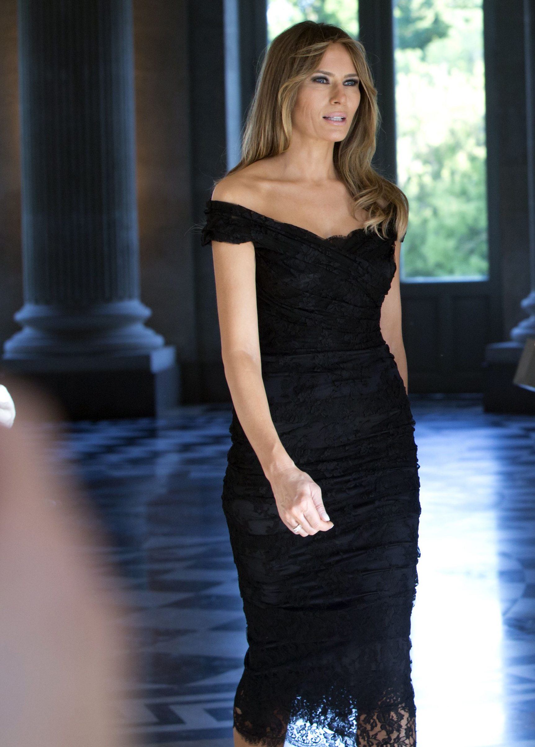 First lady Melania Trump wearing a Dolce & Gabbana black lace dress, walks prior to a group photo during the spouse and partner program at the Royal Palace of Laeken, near Brussels, 25,  May 2017.
