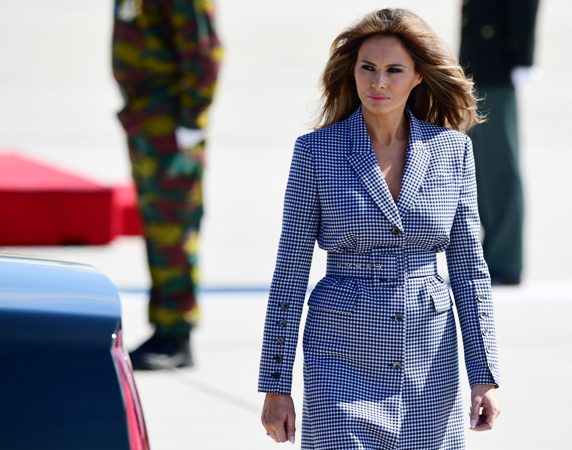 First lady Melania Trump wearing a Michael Kors coat dress, walks upon arrival at the Melsbroek military airport in Steenokkerzeel on May 24, 2017, on the eve of the NATO summit.