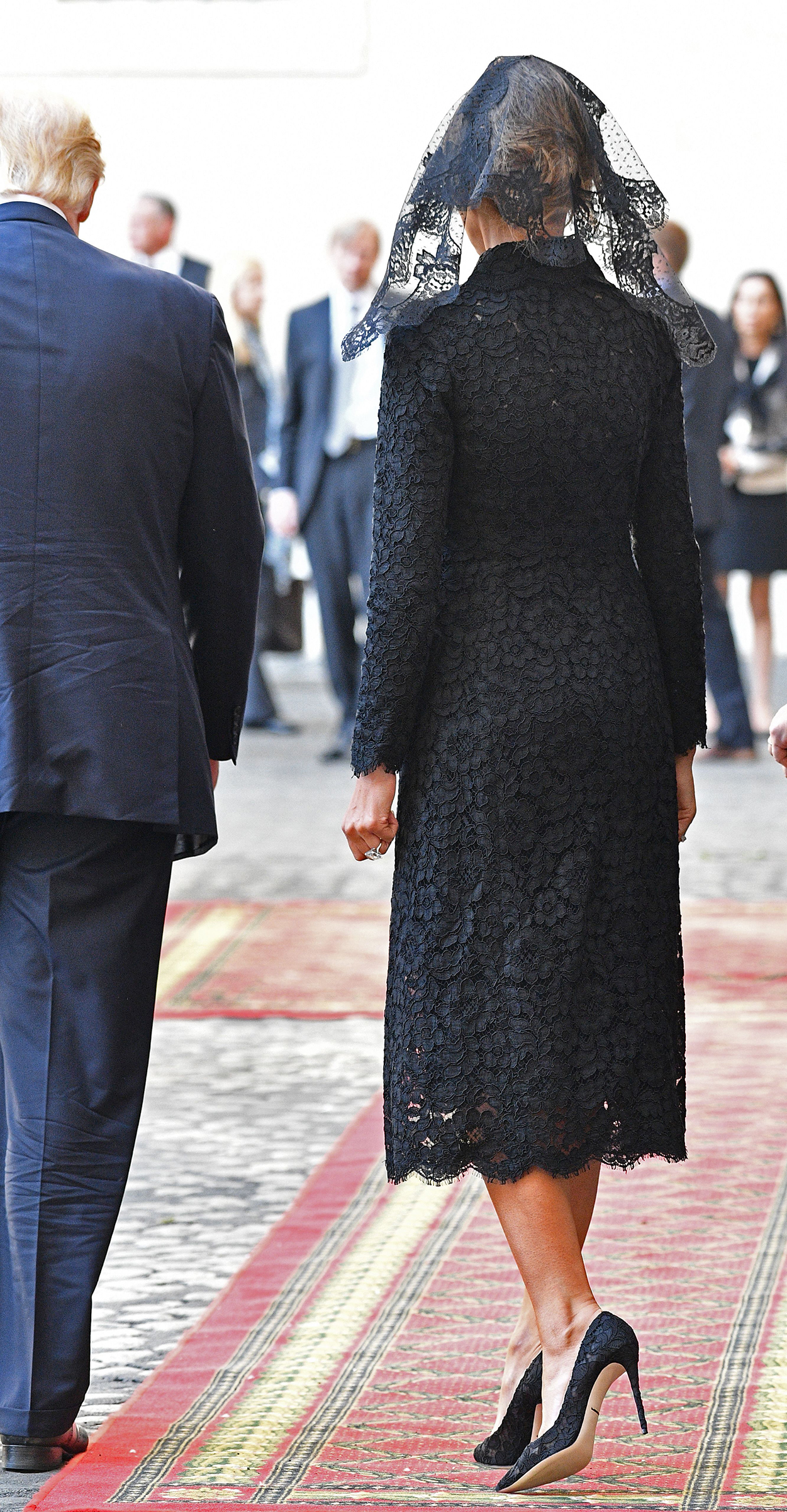 First lady Melania Trump  wearing a lace Dolce & Gabbana outfit, arrives at the Vatican prior a private audience of US President Donald Trump (L) with Pope Francis, on May 24, 2017.