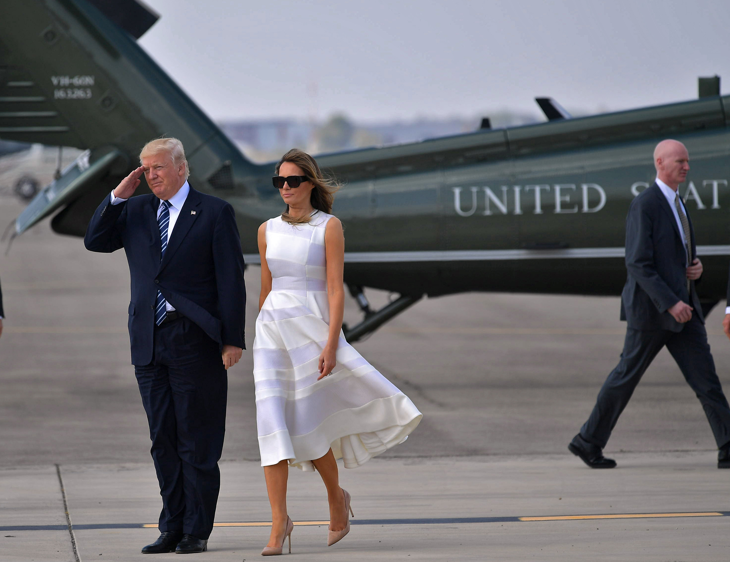 President Donald Trump and first lady Melania Trump wearing a Roksanda ivory dress, make their way to board Air Force One before departing from Ben Gurion International Airport in Tel Aviv on May 23, 2017.