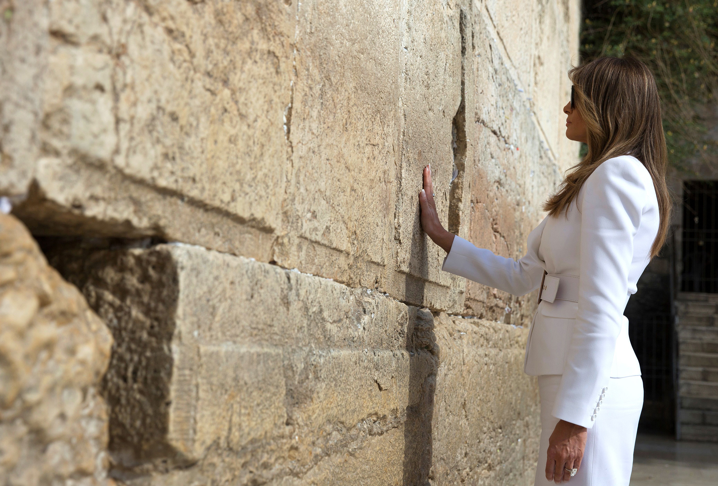 First lady Melania Trump wearing white Michael Kors Collection suit, visits the Western Wall, the holiest site where Jews can pray, in Jerusalems Old City on May 22, 2017.