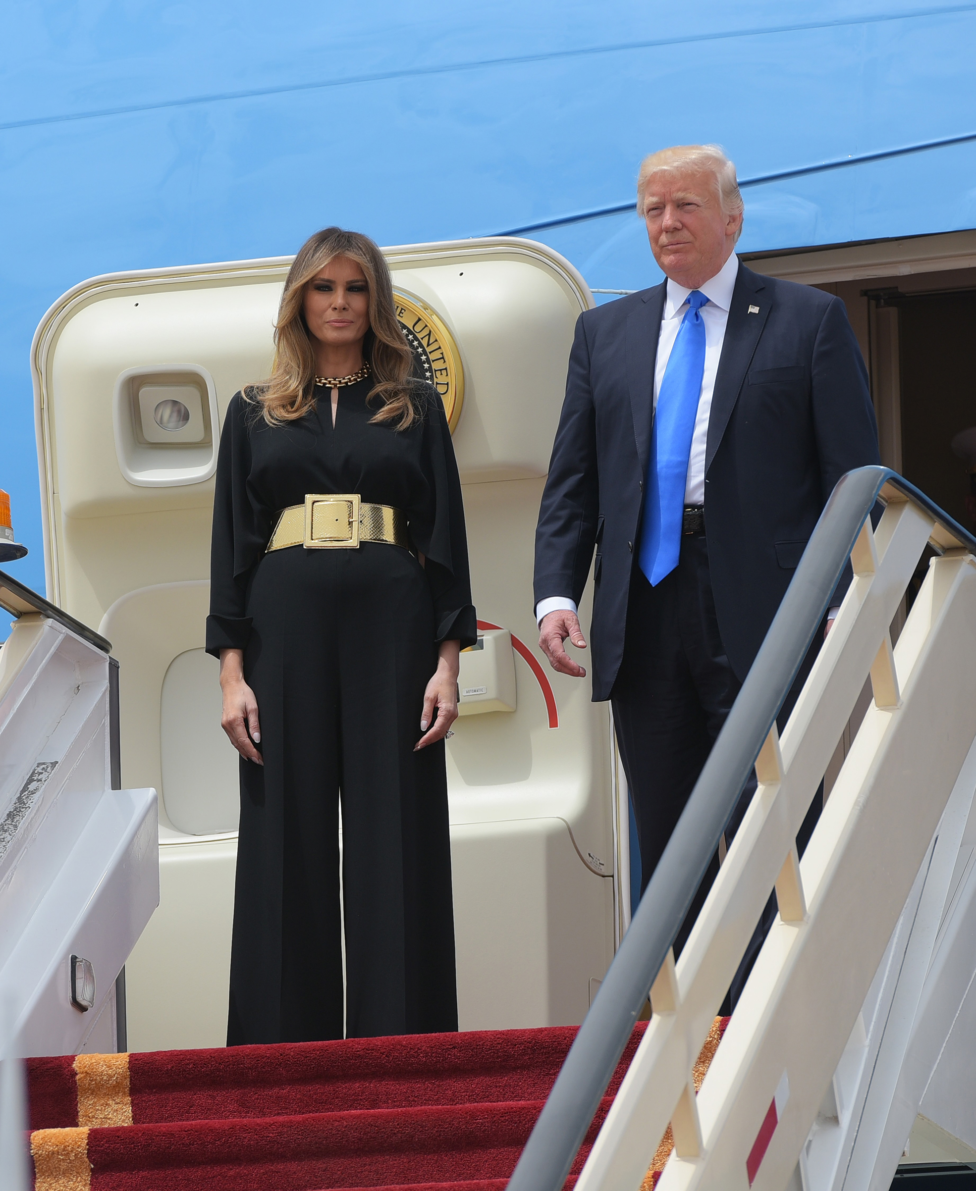 President Donald Trump and First Lady Melania Trump wearing black Stella McCartney jumpsuit and Saint Laurent belt, step off Air Force One upon arrival at King Khalid International Airport in Riyadh on May 20, 2017.
