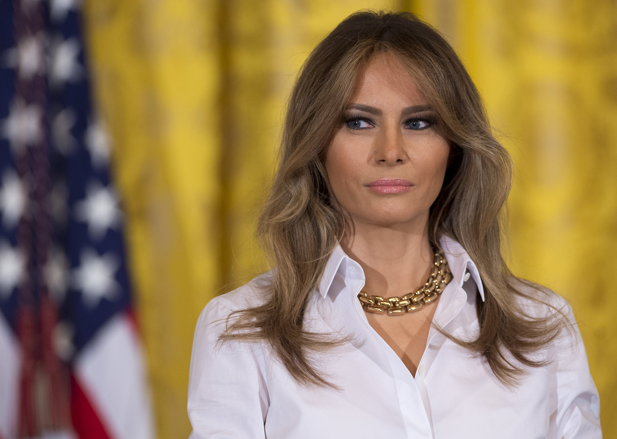 First lady Melania Trump wearing chunky, chain-link gold necklace, speaks during a Mother's Day event for military spouses in the East Room of the White House in Washington, D.C., May 12, 2017.
