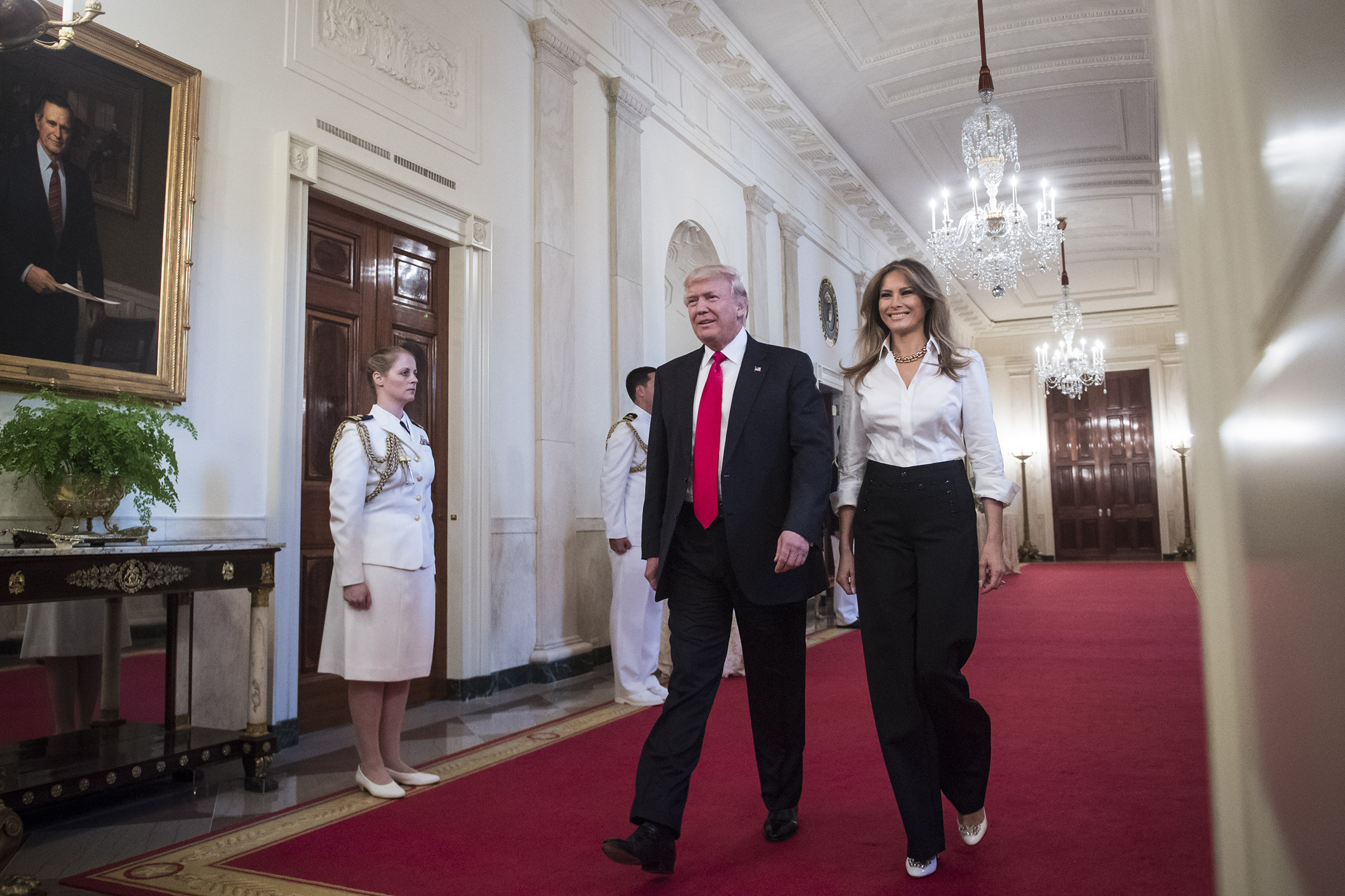 President Donald Trump and first lady Melania Trump wearing white Dolce & Gabbana button-down shirt and Ralph Lauren Collection pants,  arrive to speak to military mothers during their visit to the White House for a Mother's Day celebration in the East Room of the White House in Washington, D.C. on May 12, 2017.