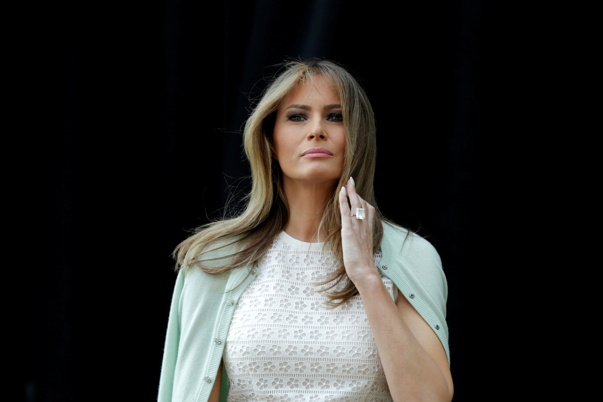 First lady Melania Trump wearing Giambattista Valli dress and a pale green cardigan, attends the opening of Bunny Mellon Healing Garden at Children's National Medical Center in Washington, D.C., April 28, 2017.