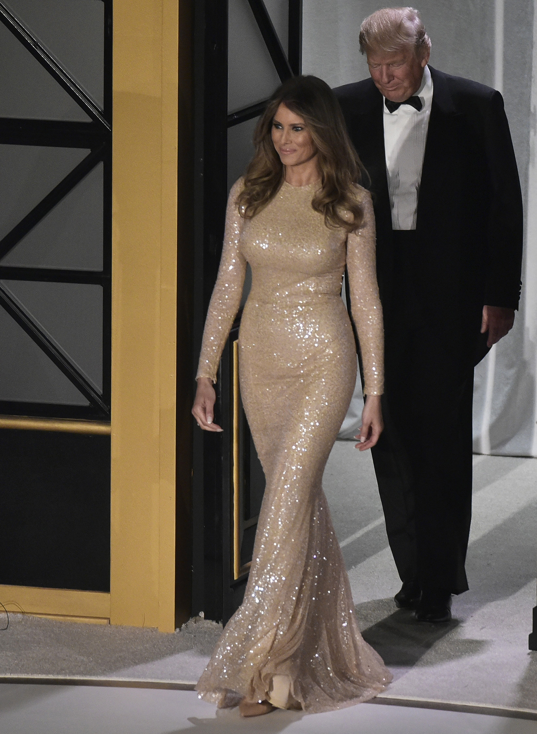 President-elect Donald Trump and wife Melania Trump wearing a Reem Acra embellished gown,  arrive for a  reception and dinner at Union Station in Washington, D.C. on Jan. 19, 2017.