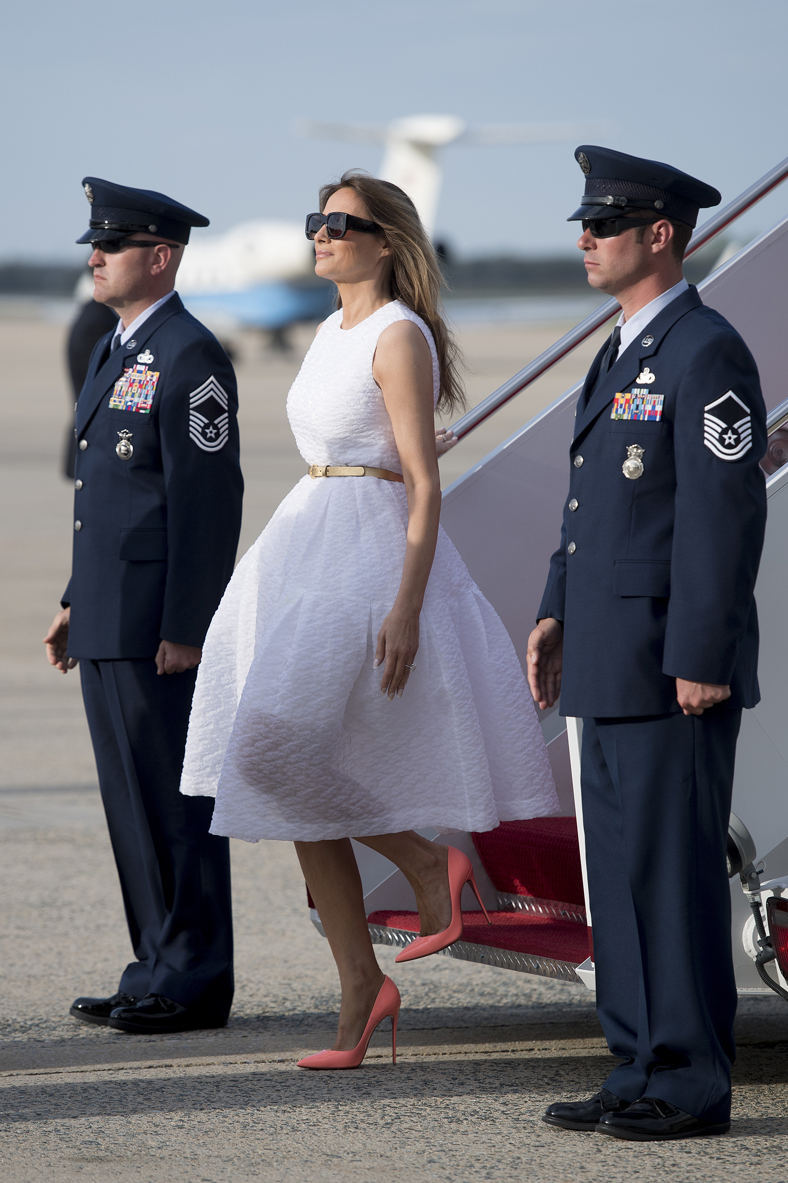 First lady Melania Trump wearing Simone Rocha dress and Christian Louboutin shoes, walks off Air Force One at Andrews Air Force Base, Md., April 16, 2017.