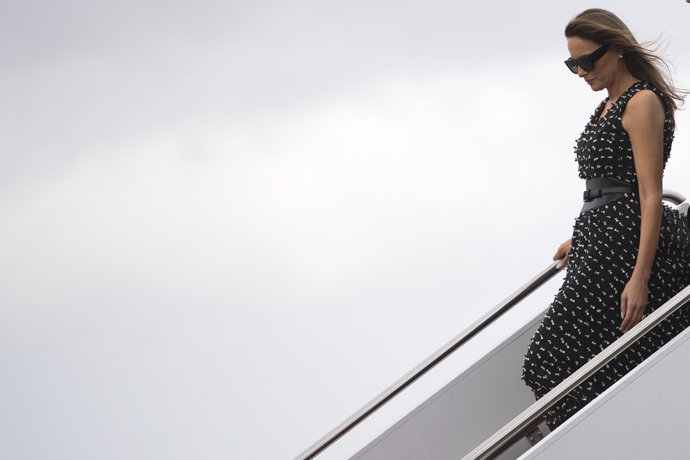 First Lady Melania Trump wearing black and white textured dress,  arrives in West Palm Beach, Fla.,                               April 6, 2017.