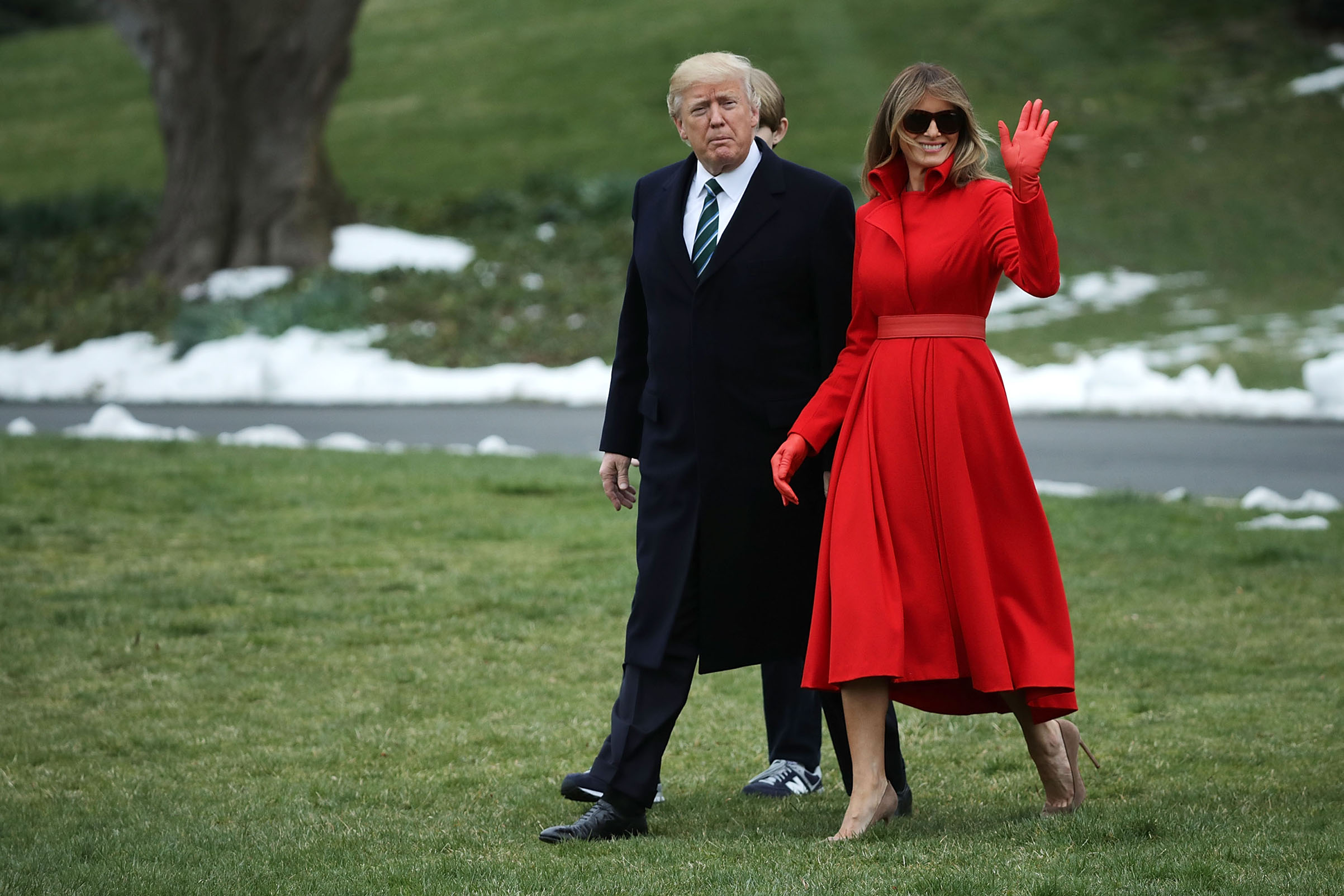 President Donald Trump, first lady Melania Trump wearing a custom made coatdress by designer Alice Roi,  and their son Barron Trump depart the White House, March 17, 2017.