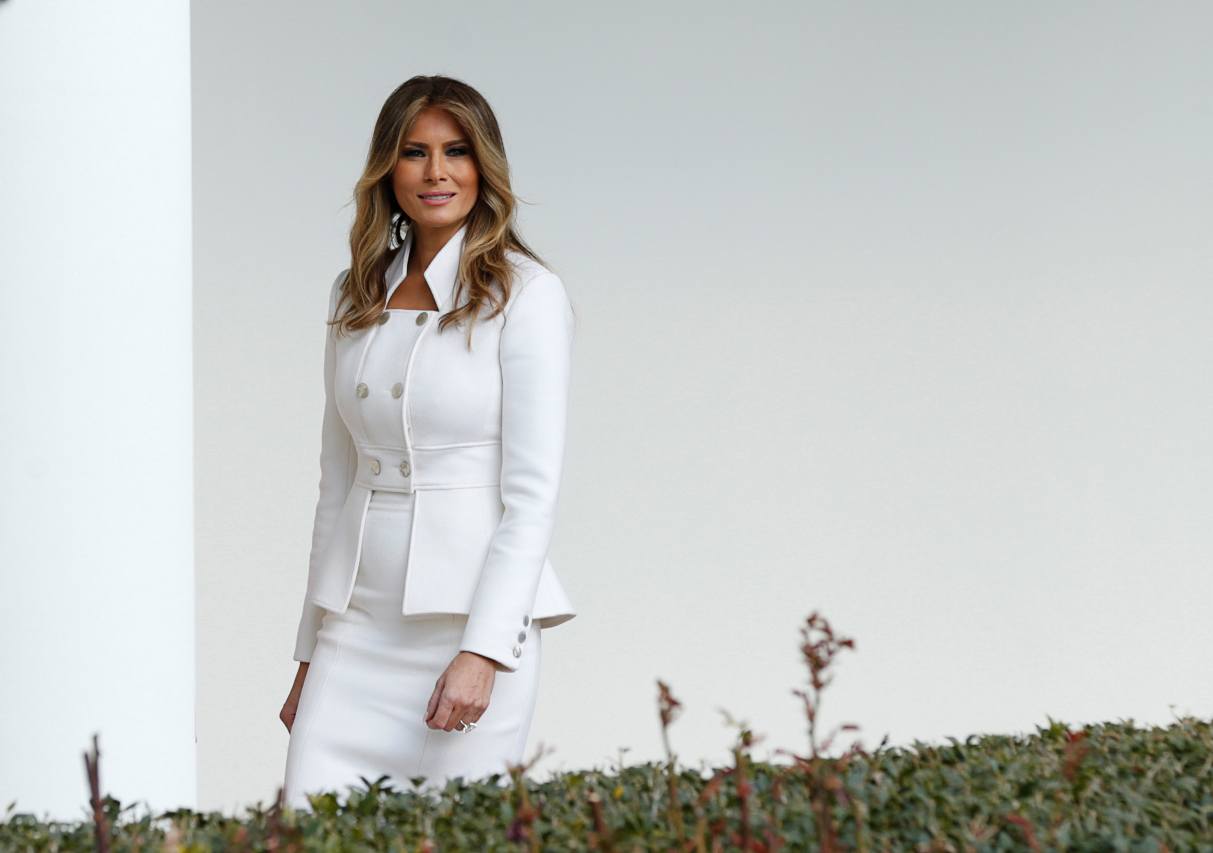 First lady Melania Trump wearing custom Karl Lagerfield outfit,  walks along the Colonnade at the White House, Feb. 15, 2017.
