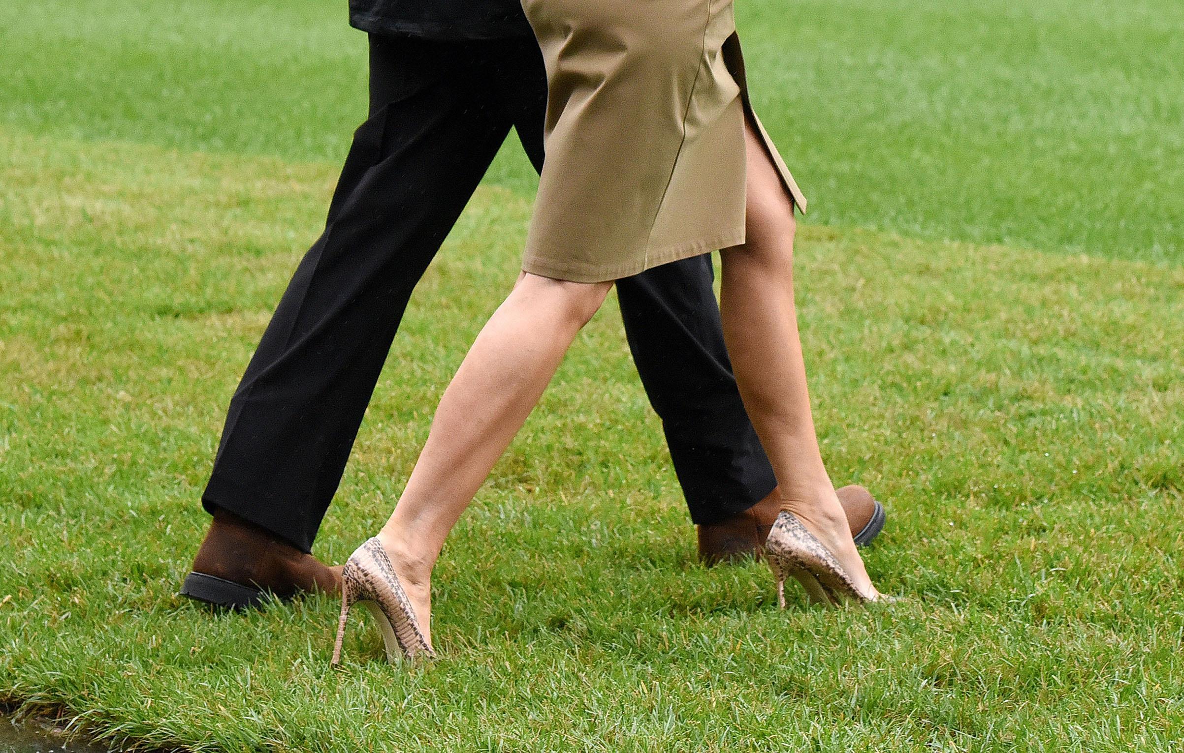 President Donald Trump walks with first lady Melania Trump wearing Manolo Blahnik snakeskin stilettos , prior to their departure to Hurricane Harvey Sept. 2, 2017 in Washington, DC.