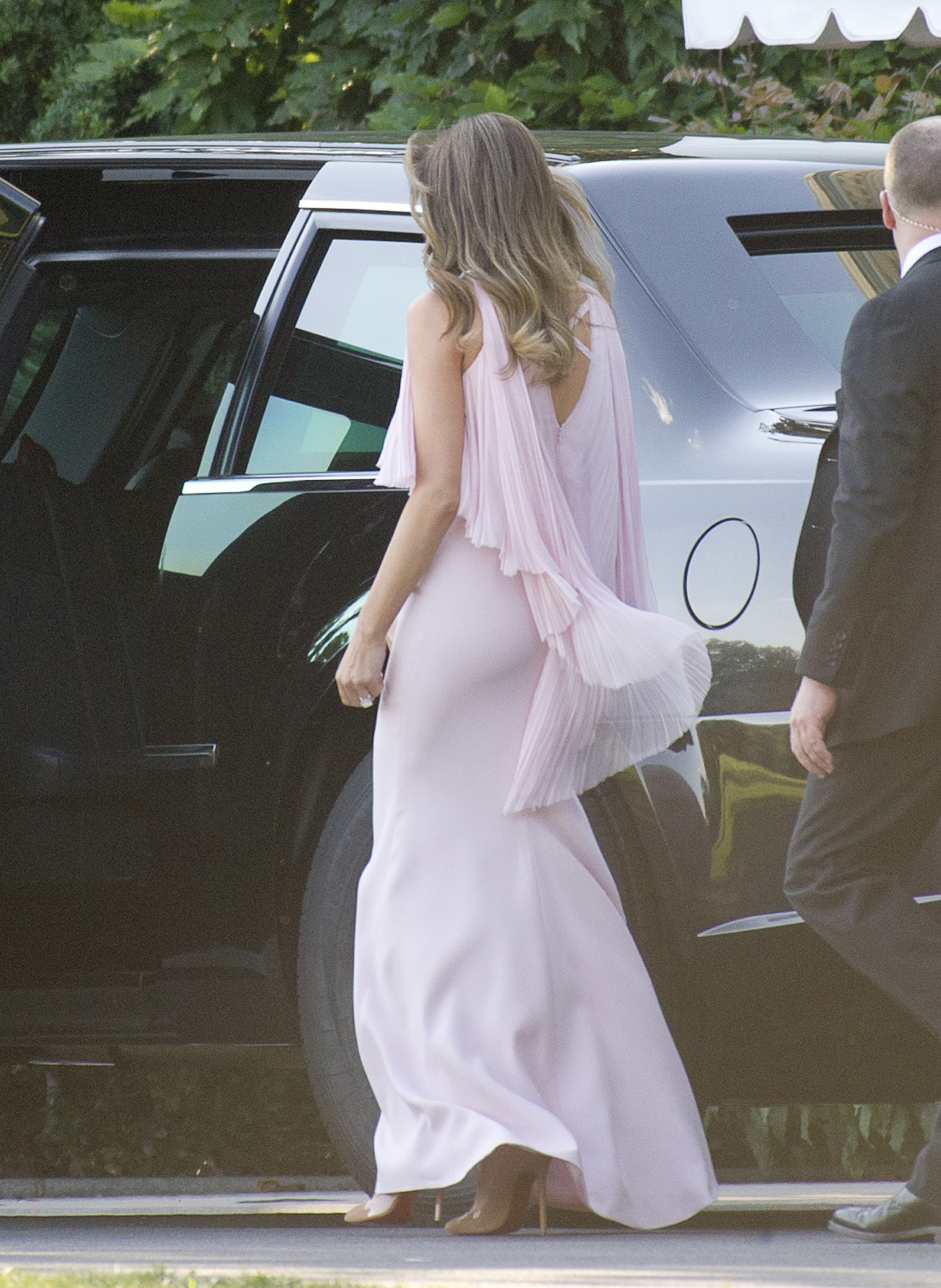 President Donald J. Trump and first lady Melania Trump wearing a J. Mendel chiffon gown with Manolo Blahnik shoes, departs the White House on route to a wedding, June 24, 2017.