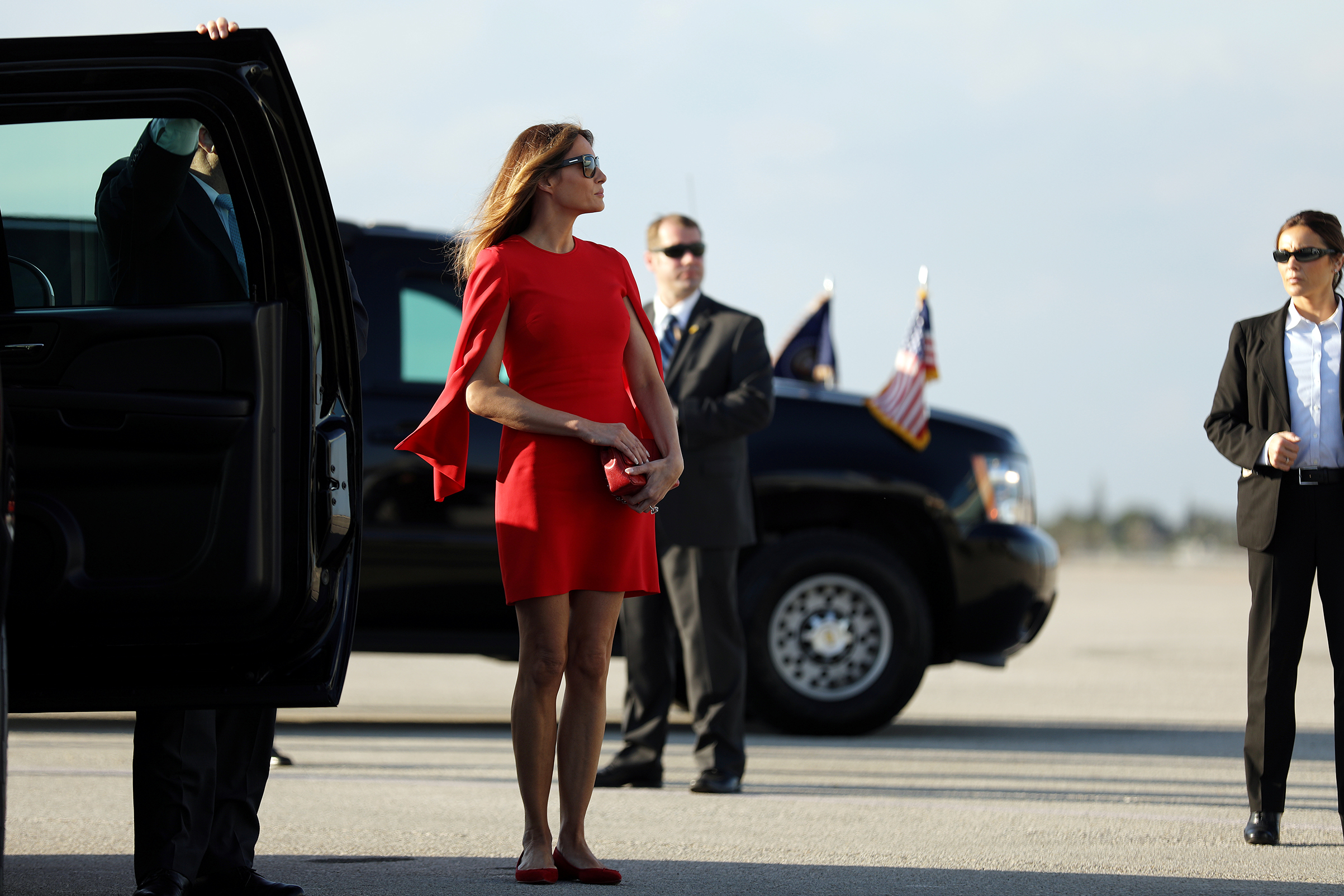 First lady Melania Trump wearing Givenchy red split-sleeve dress and red flats arrives to welcome U.S. President Donald Trump (not pictured) at West Palm Beach International airport in West Palm Beach, Fla., Feb. 3, 2017.