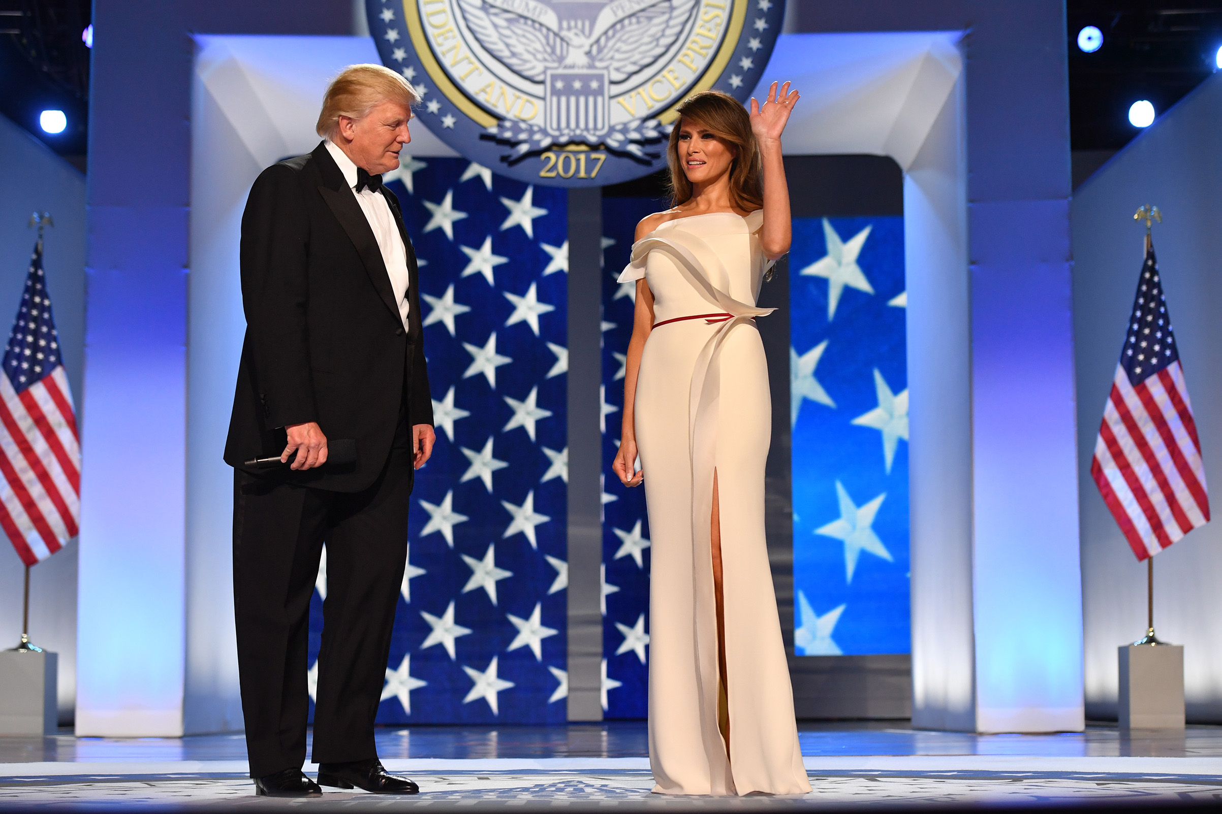 President Donald Trump with First lady Melania Trump, wearing a white, off-the-shoulder gown by Hervé Pierre,  arrive at the Freedom Ball on Jan. 20, 2017 in Washington, D.C.