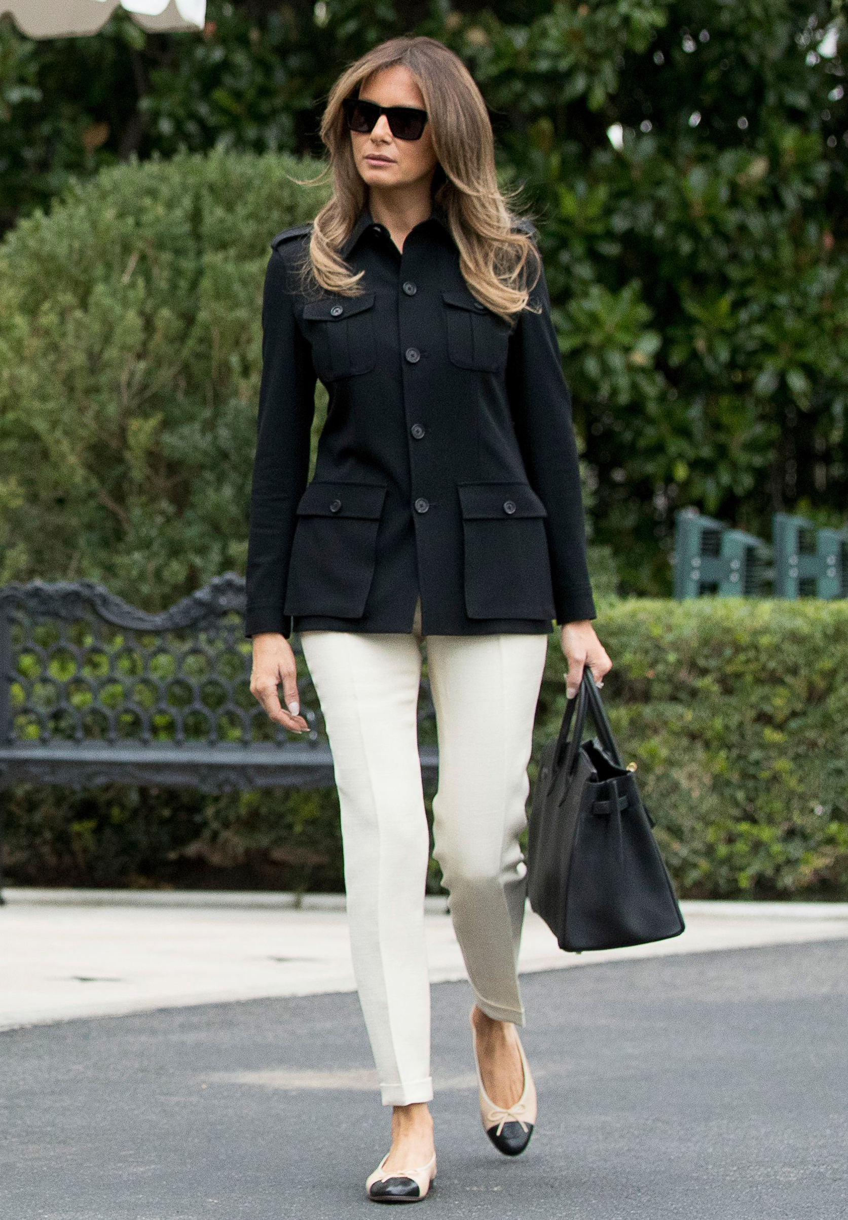 First lady Melania Trump, wearing Chanel shoes and carrying a Hermès bag on way to board Marine One on route to Fort Myers, Fla., to meet with citizens impacted by Hurricane Irma, Washington, D.C., Sept. 14, 2017.