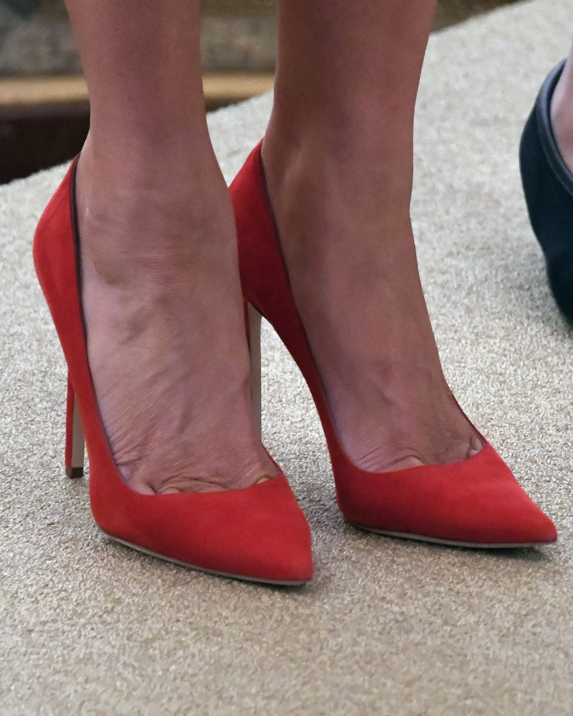 Red shoes worn by first lady Melania Trump as she and United States President Donald J. Trump host a Hispanic Heritage Month at the White House in Washington, D.C., Oct. 6, 2017.