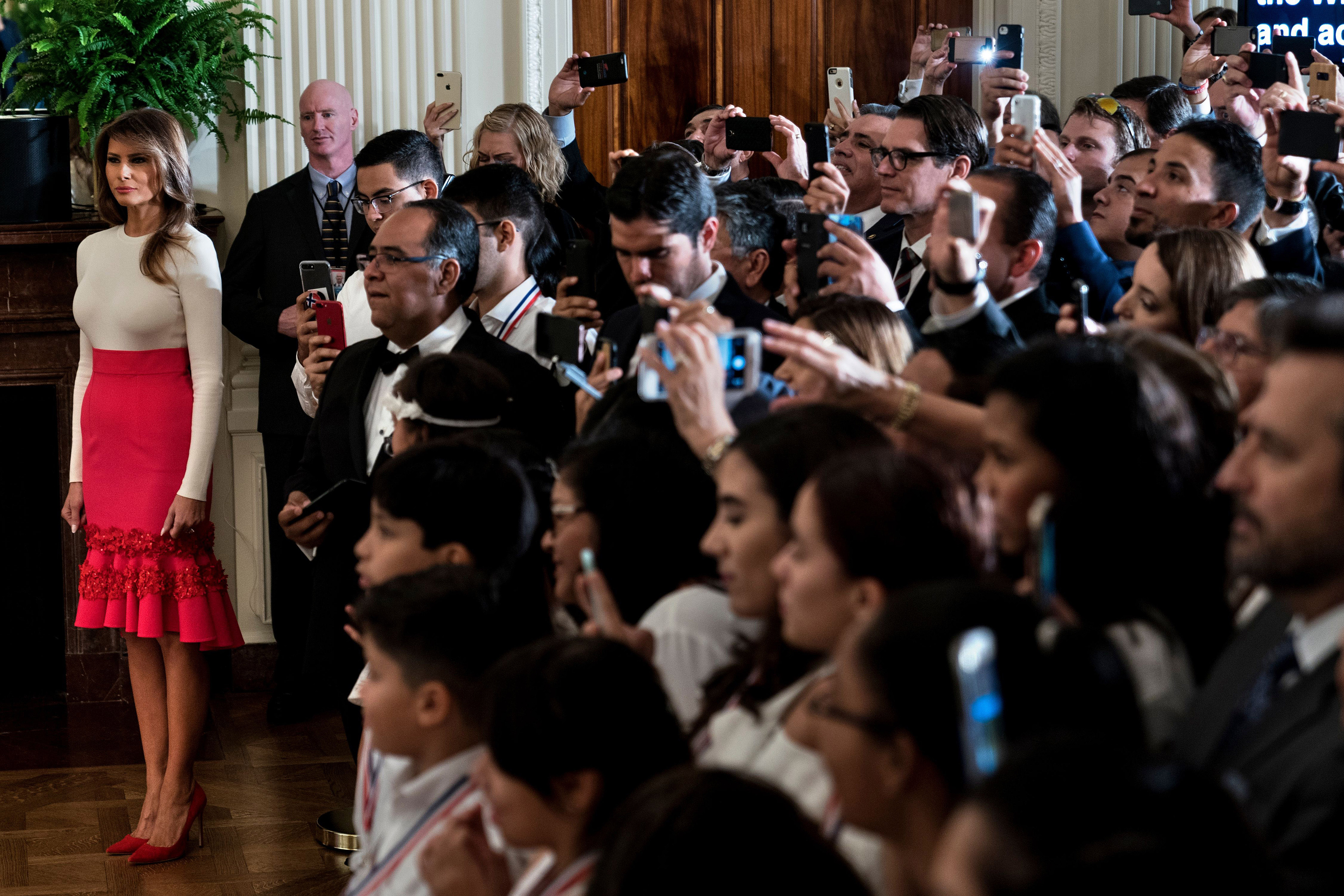 First lady Melania Trump wearing a flamenco-style red skirt and off-white top during a Hispanic Heritage Month event in the East Room of the White House Oct. 6, 2017.