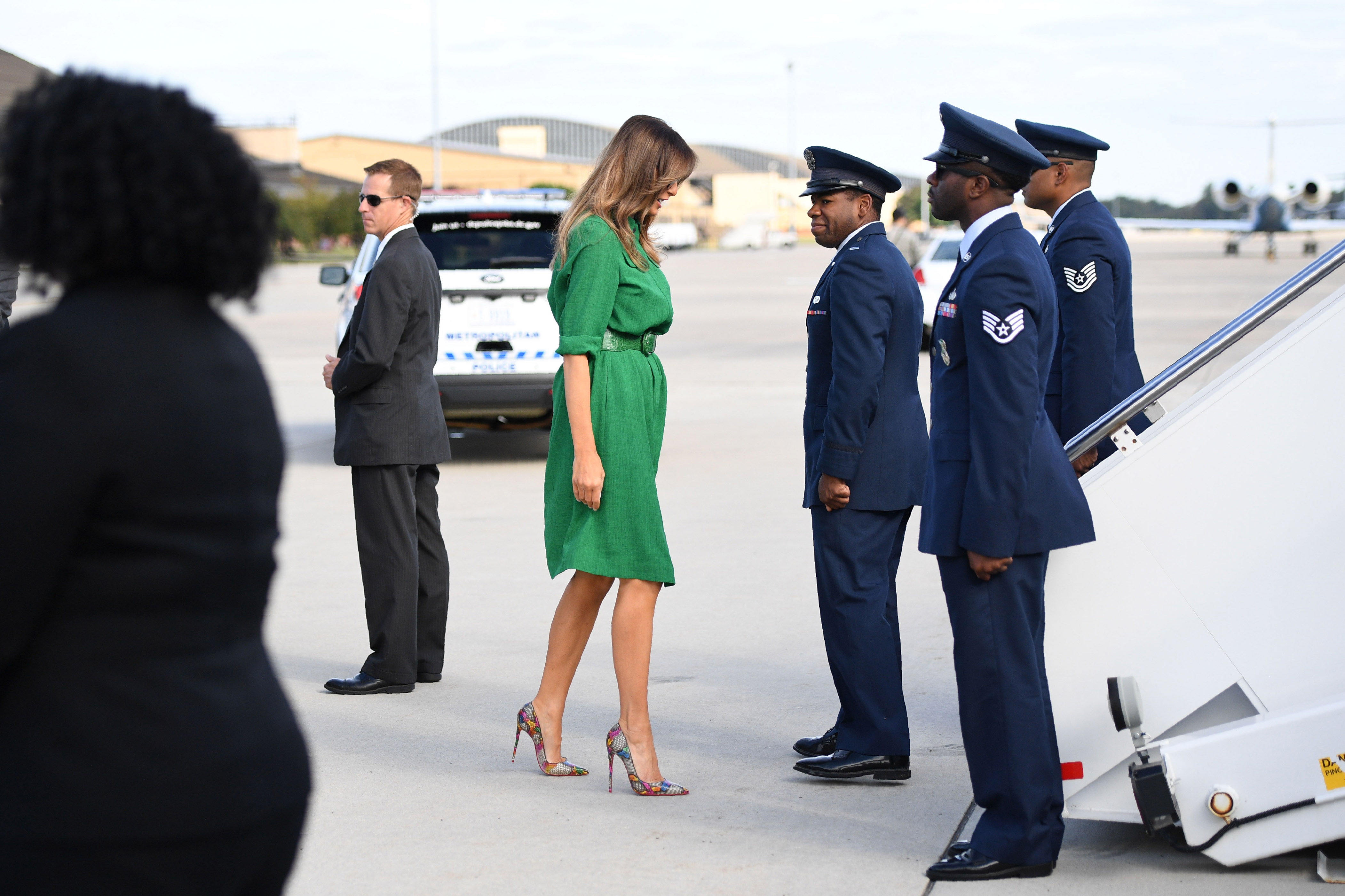 First lady Melania Trump (C) wearing a Cefinn Studio dress, (designer brand of Samantha Cameron, wife of former British Prime Minister David Cameron), prepares to board a plane at Joint Base Andrews near Washington, D.C. on Oct. 10, 2017.
