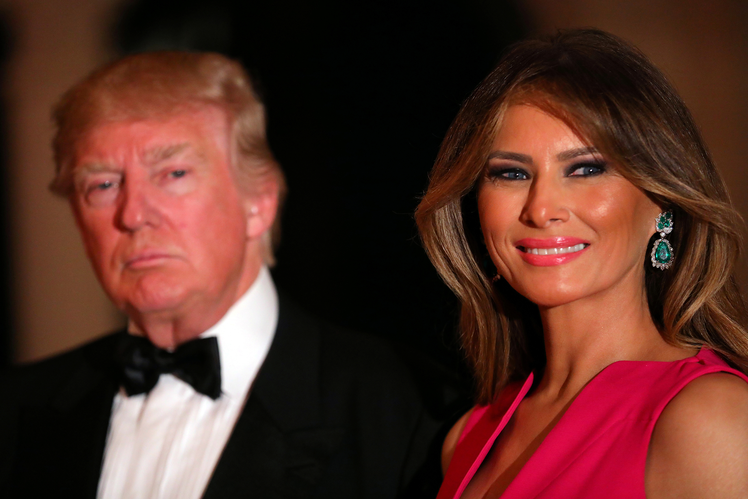 First lady Melania Trump wearing bright pink Dior gown with emerald and diamond earrings, attends the 60th Annual Red Cross Gala at Mar-a-Lago club in Palm Beach, Fla., Feb. 4, 2017.