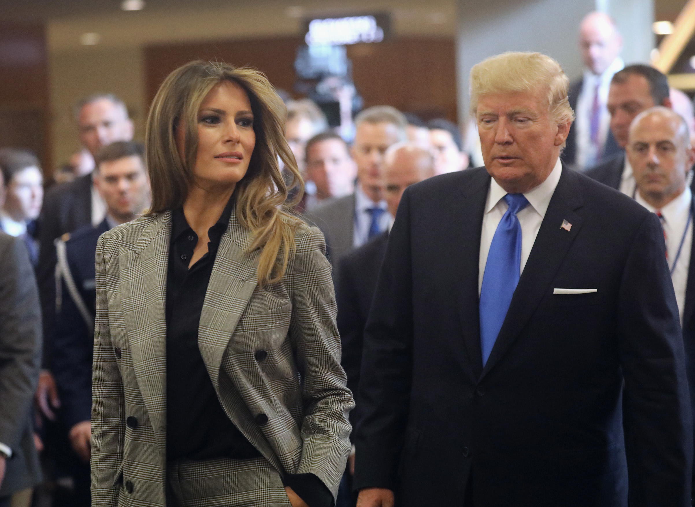 First lady Melania Trump wearing a pants suit by the Ralph Lauren Collection and President Donald Trump depart the United Nations after the president's speech on Sept. 19, 2017 in New York City.