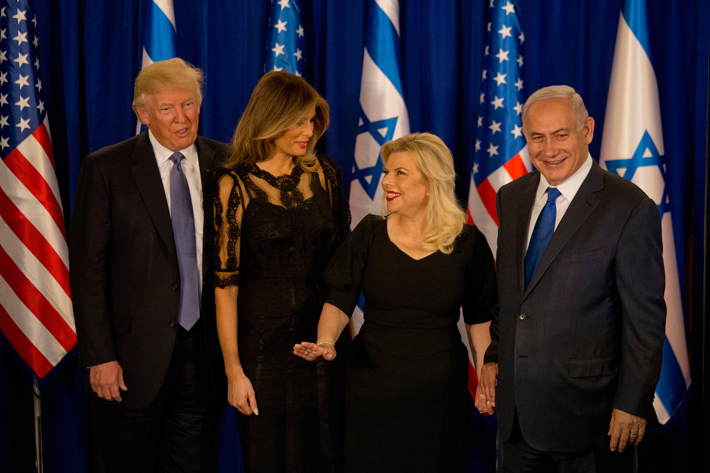 President Donald Trump and his wife Melania wearing Dolce & Gabbana, and Israeli Prime Minister Benjamin Netanyahu and his wife Sara stand after their meeting in Jerusalem                               Israel, May 22, 2017.