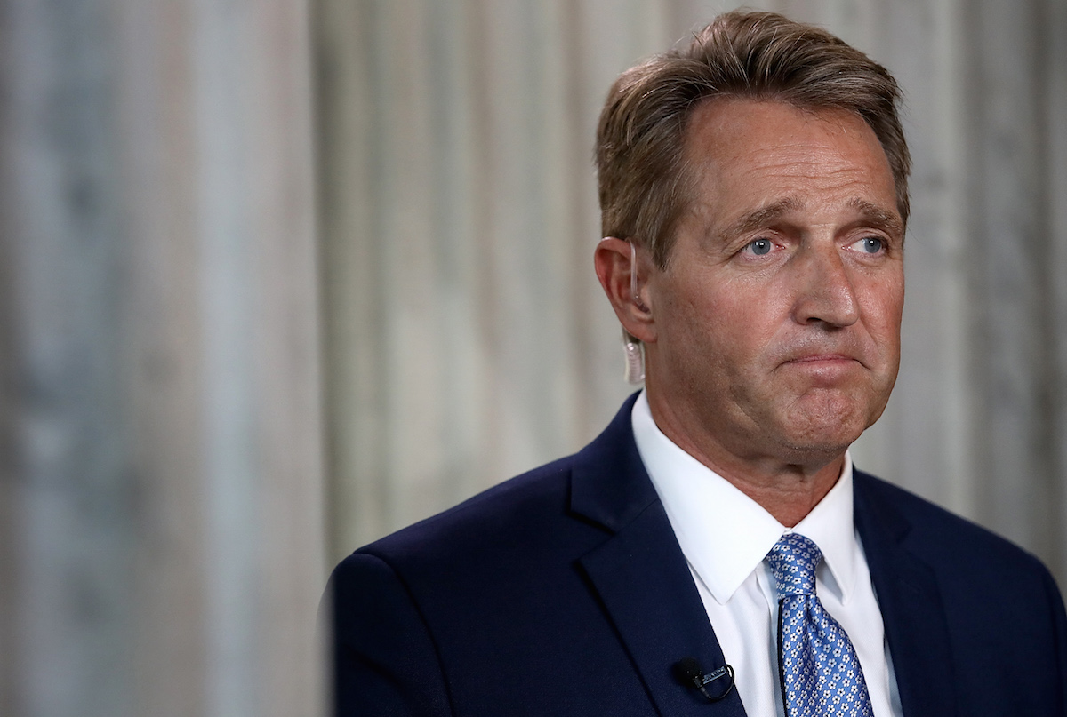 Sen. Jeff Flake (R-AZ) speaks to reporters on Capitol Hill after announcing he will not seek re-election Oct. 24, 2017 in Washington, DC.