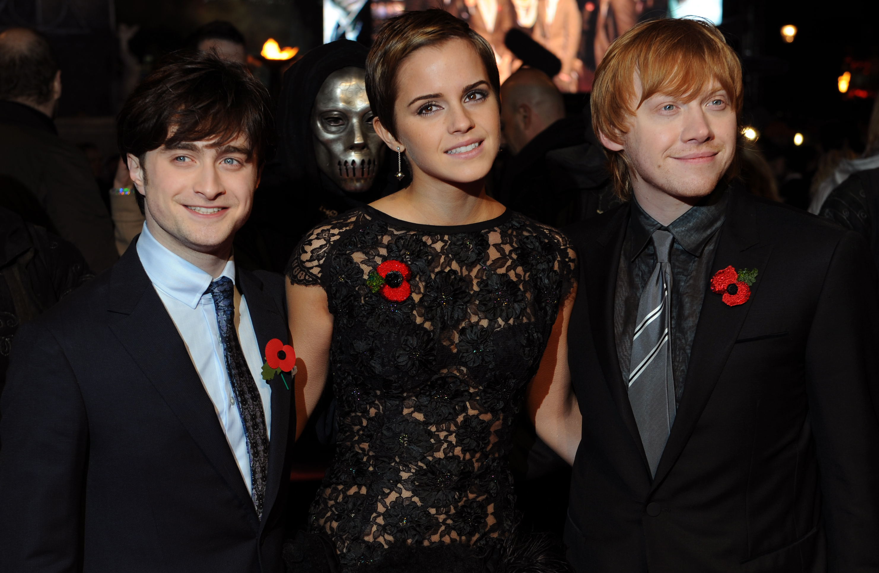 Daniel Radcliffe (L), Emma Watson, (C) and Rupert Grint pose for photographers as they arrive to attend the World Premiere of 'Harry Potter And The Deathly Hallows: Part One' in Leicester Square, central London on November 11, 2010.