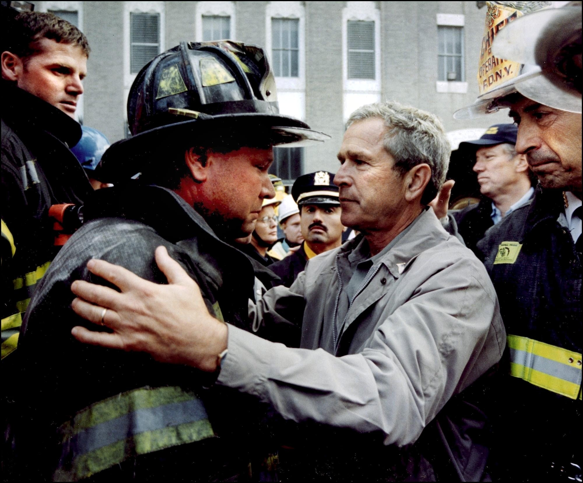 On Sept. 14, 2001, in New York City, President George Bush comforts New York City Fire Dept Lt Lenard Phelan of Battalion 46, following the terrorist attacks on the on the World Trade Center.