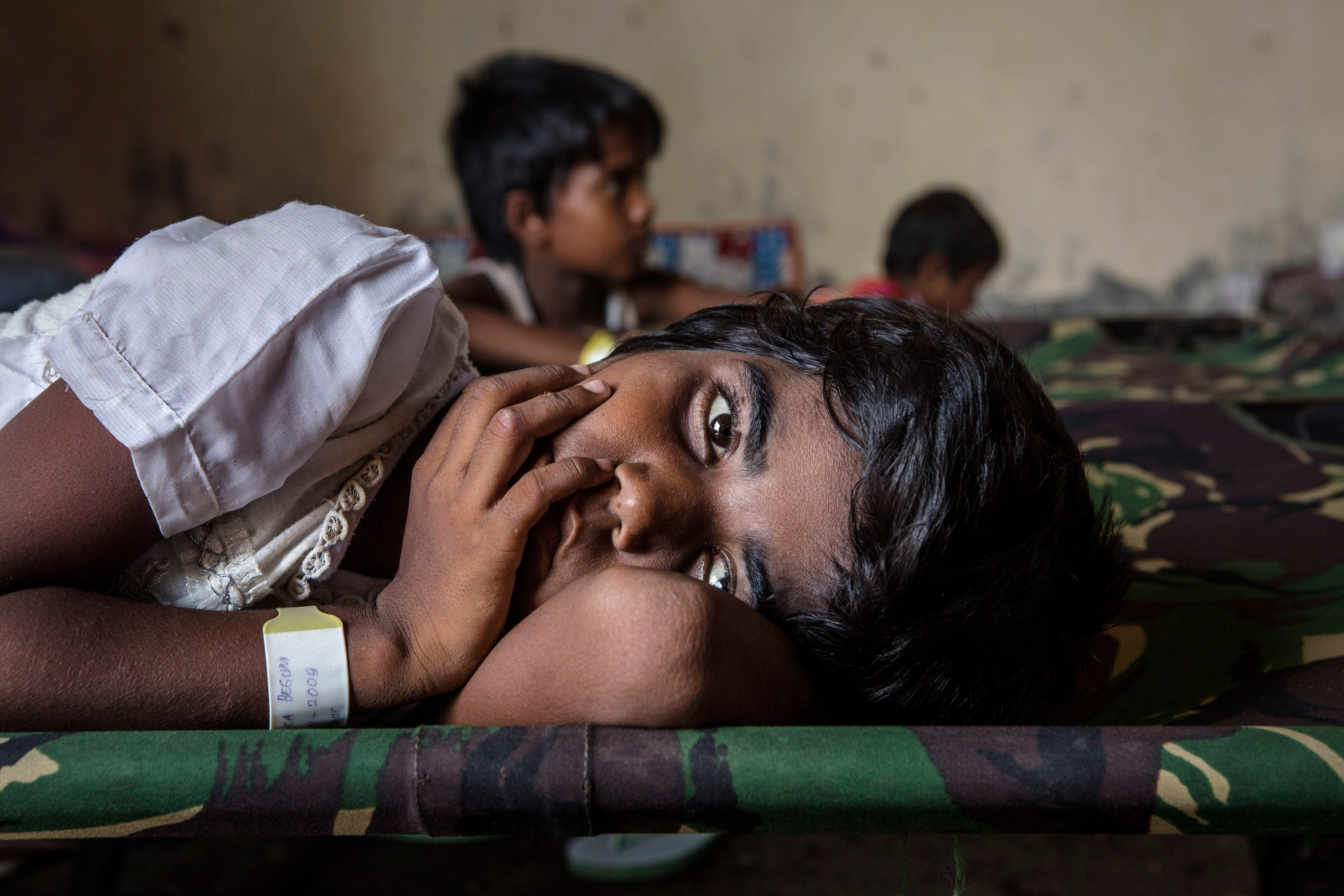A Rohingya girl rests at a refugee shelter Aceh, Indonesia on May 19, 2015.