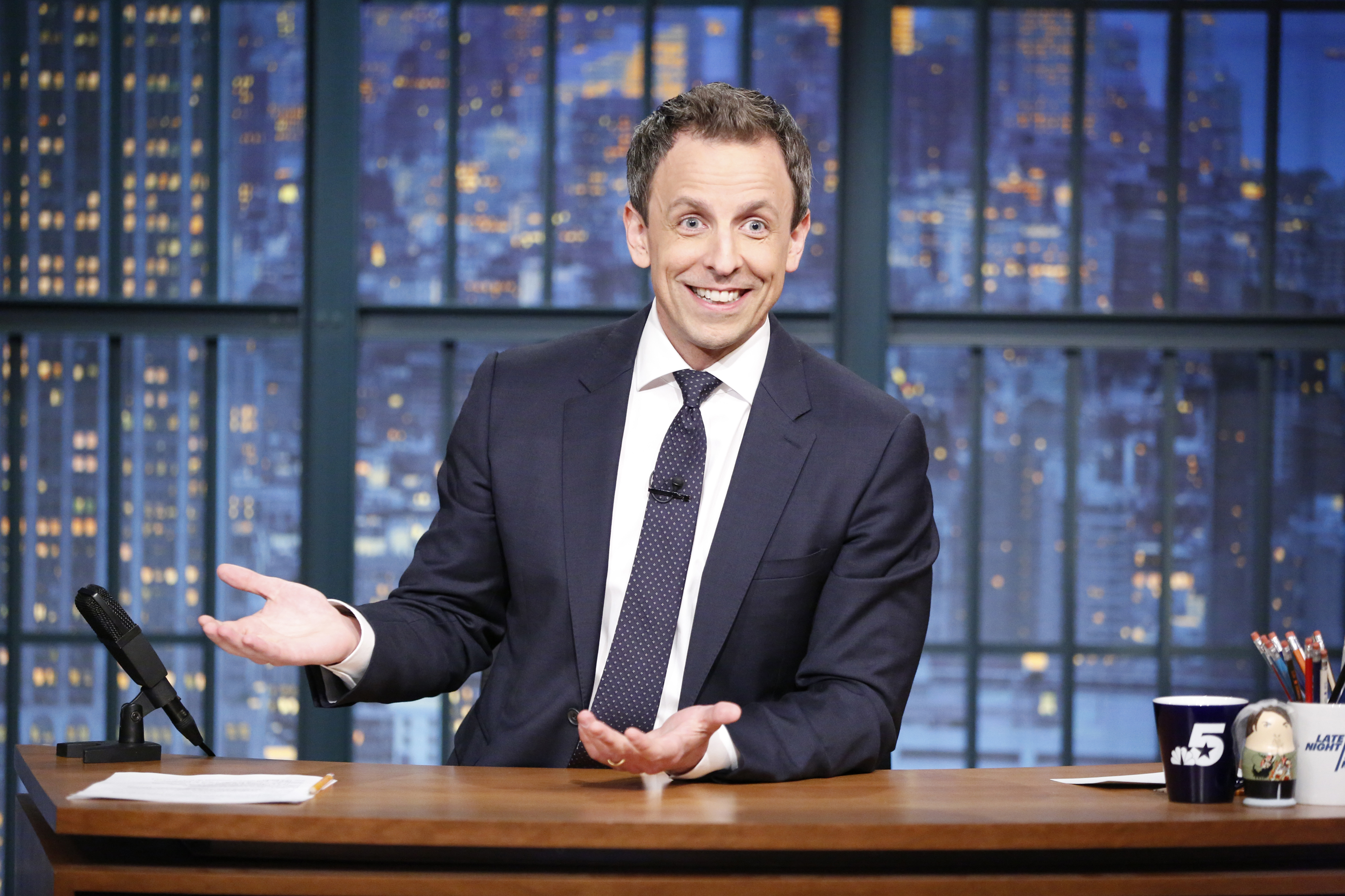 Host Seth Meyers at his desk